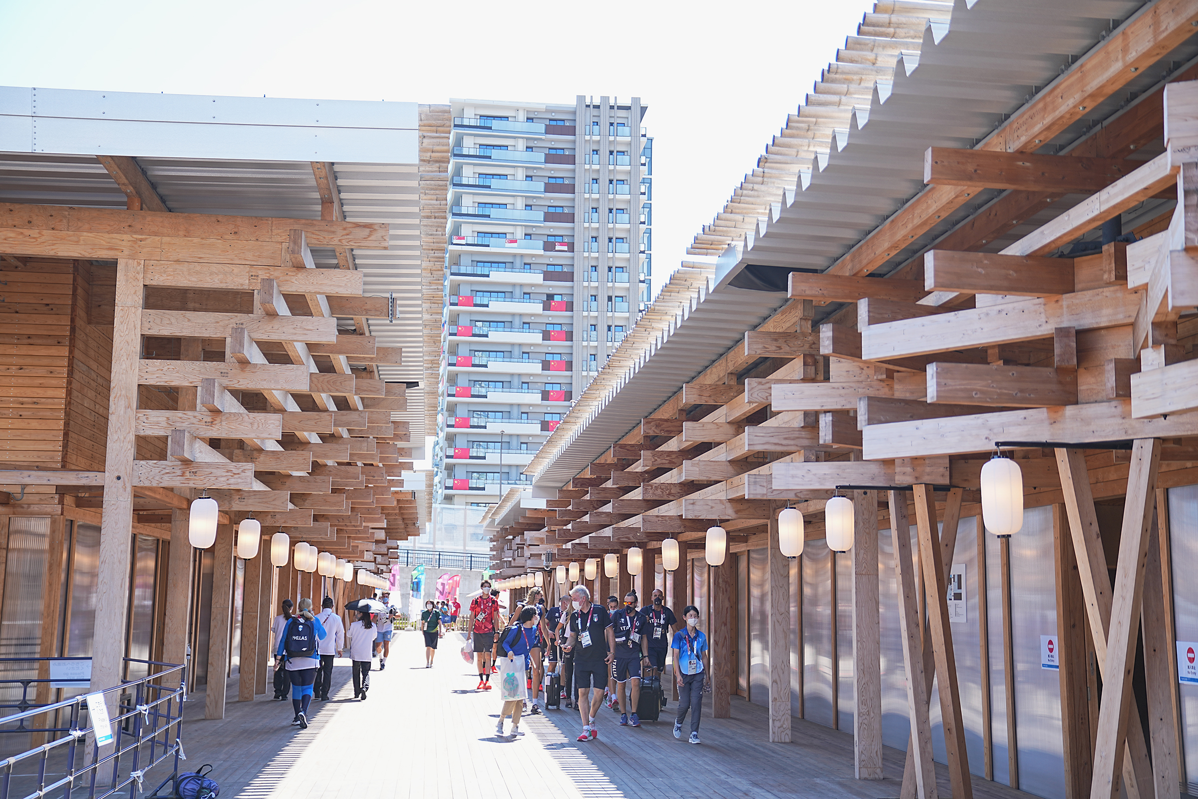 Athletes walk through the Tokyo Olympic Village on Wednesday, July 21.