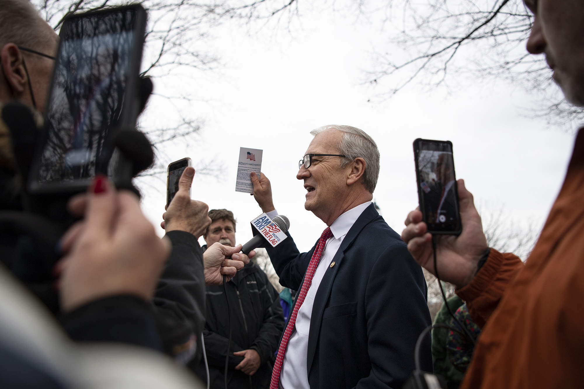 Sen. Kevin Cramer, R-N. Dak., holds up a copy of the Constitution while talking to Trump supporters in front of the U.S. Capitol in Washington DC, on Tuesday, January 5.