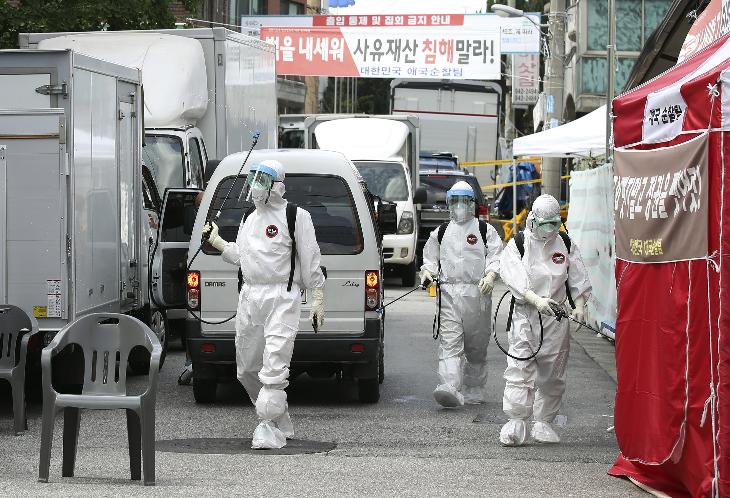 Public officials disinfect as a precaution against the coronavirus near the Sarang-jeil church in Seoul, South Korea on August 16.