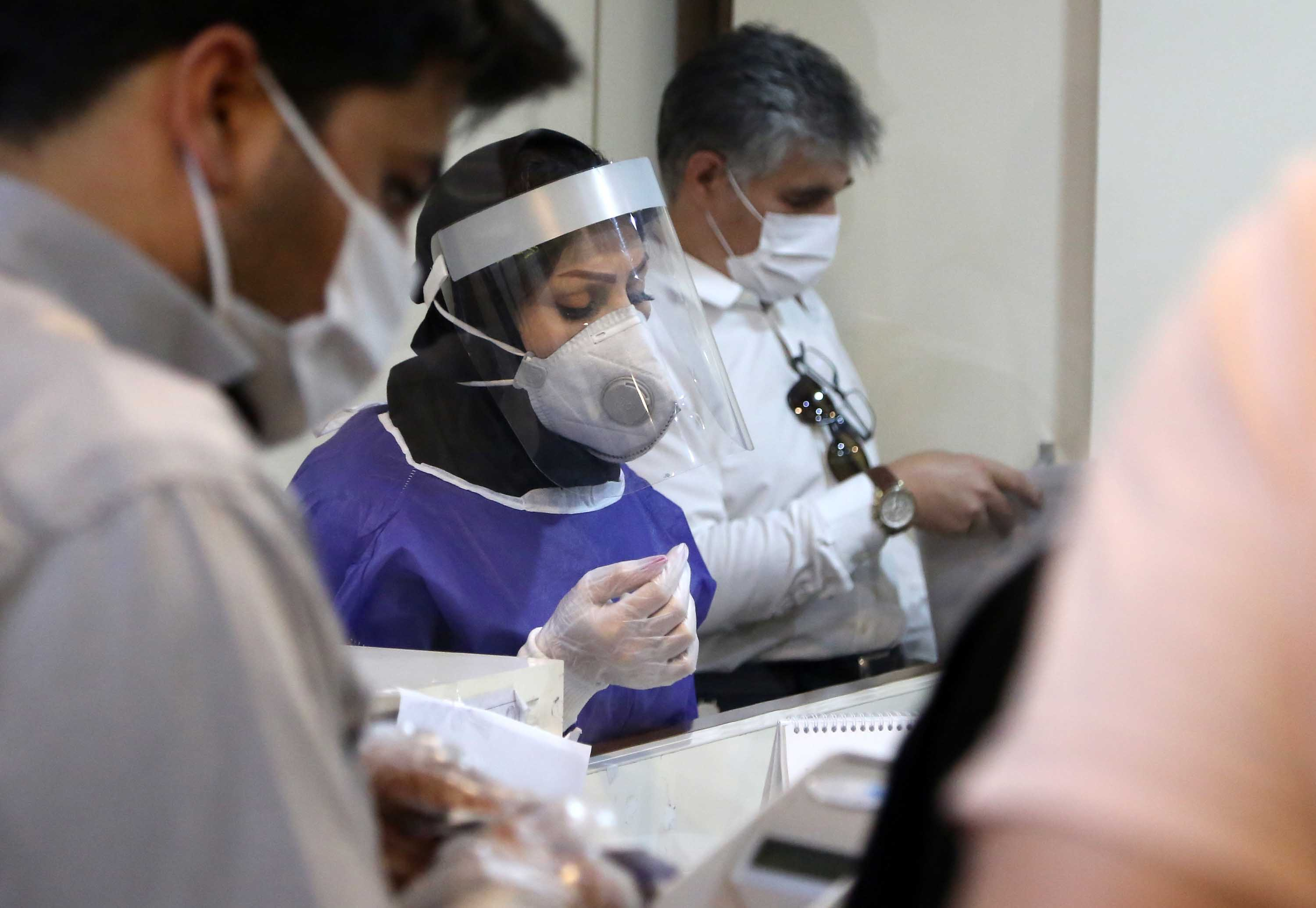 Medical professionals work at a coronavirus testing laboratory in Tehran, Iran, on July 14.