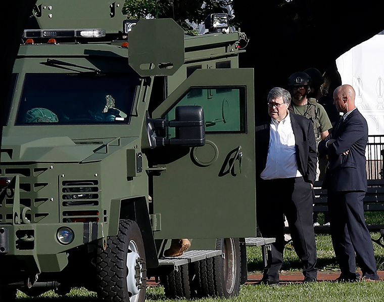 Attorney General William Barr, center, stands in Lafayette Park across from the White House as demonstrators gather to protest the death of George Floyd, Monday, June 1.