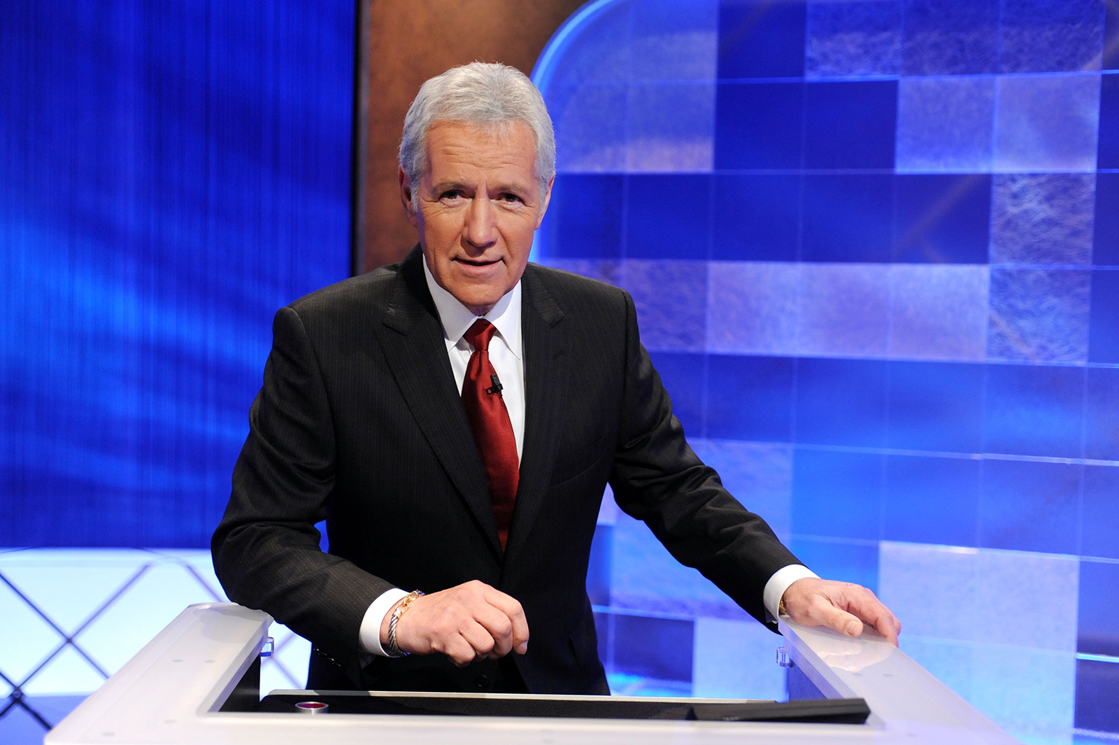 """Game show host Alex Trebek poses on the set of the """"Jeopardy!"""" Million Dollar Celebrity Invitational Tournament Show Taping on April 17, 2010 in Culver City, California."""
