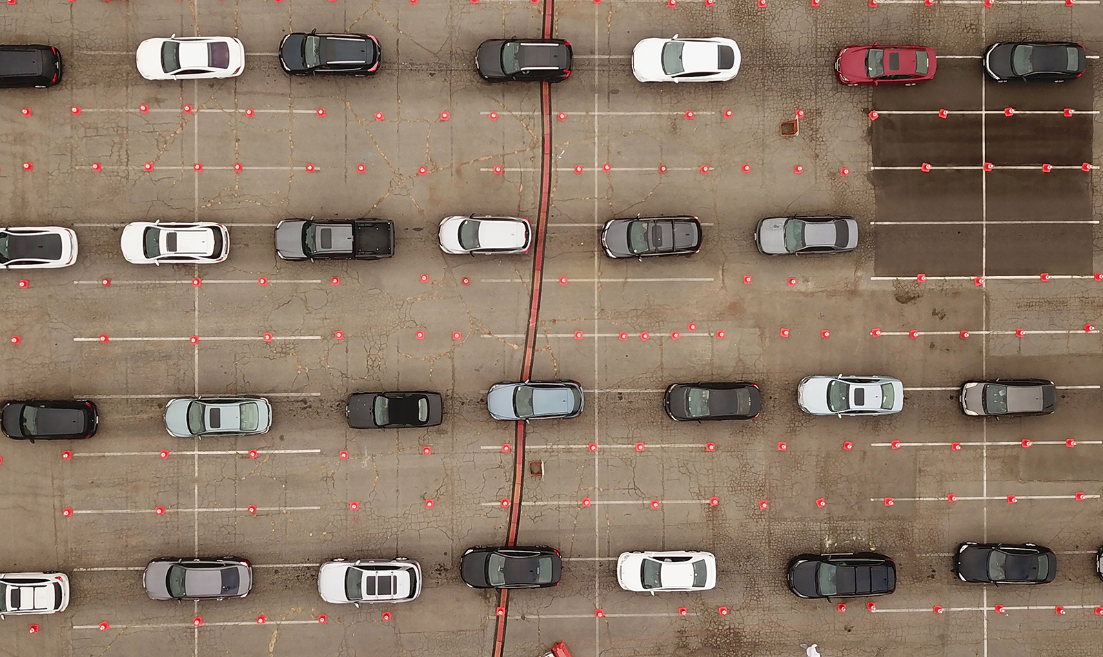 This aerial view shows people waiting in line in their cars at a Covid-19 testing site at Dodger Stadium in Los Angeles, California, Nov. 18.