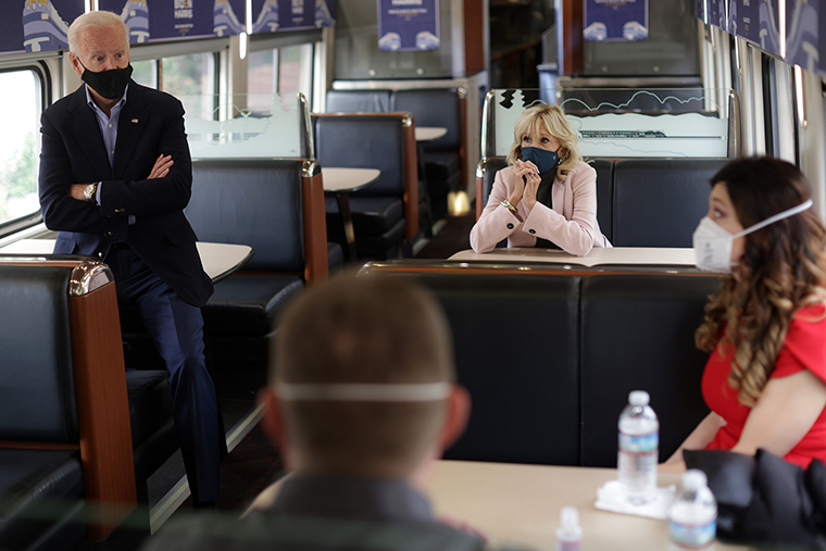 Joe Biden and wife Dr. Jill Biden listen to supporters on a train campaign tour Wednesday, September 30, in Alliance, Ohio.