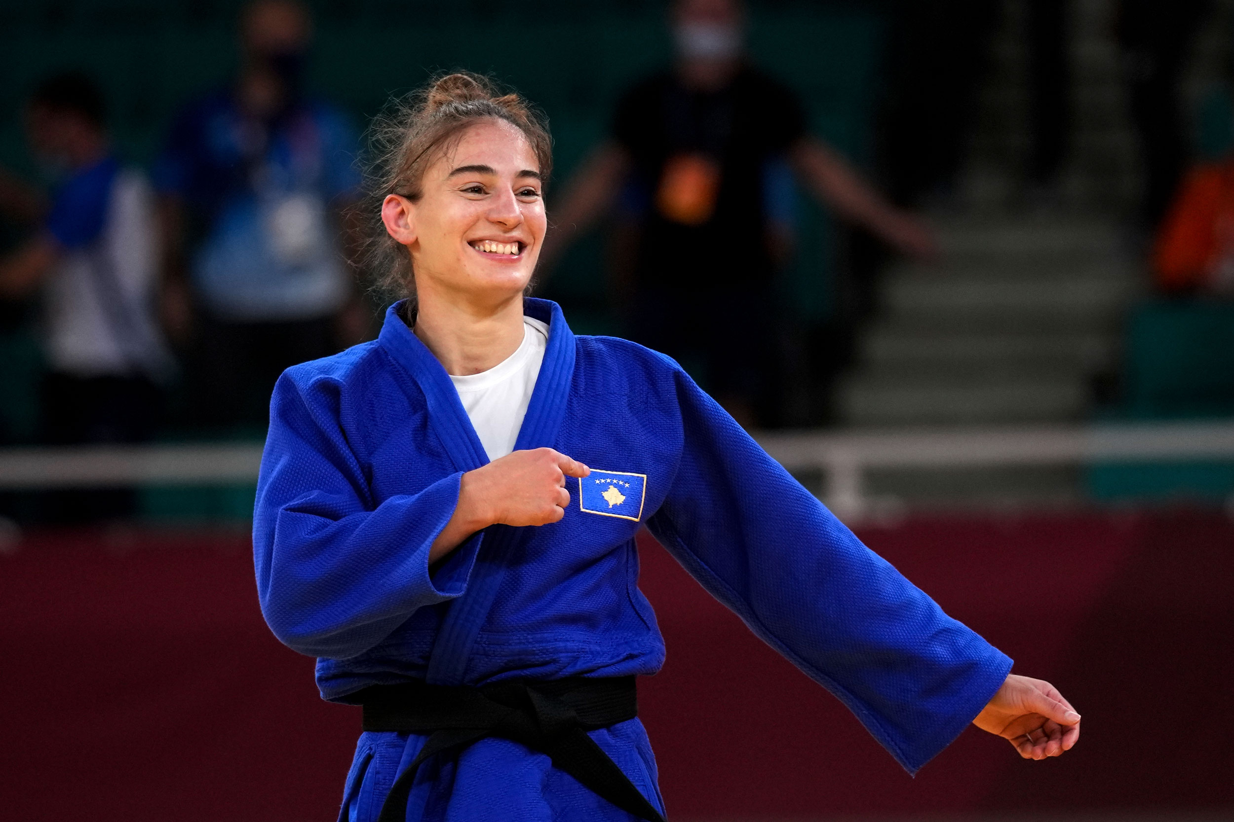 Kosovo's Nora Gjakova celebrates after defeating France's Sarah Leonie Cystique in their -57kg judo final match on July 26.