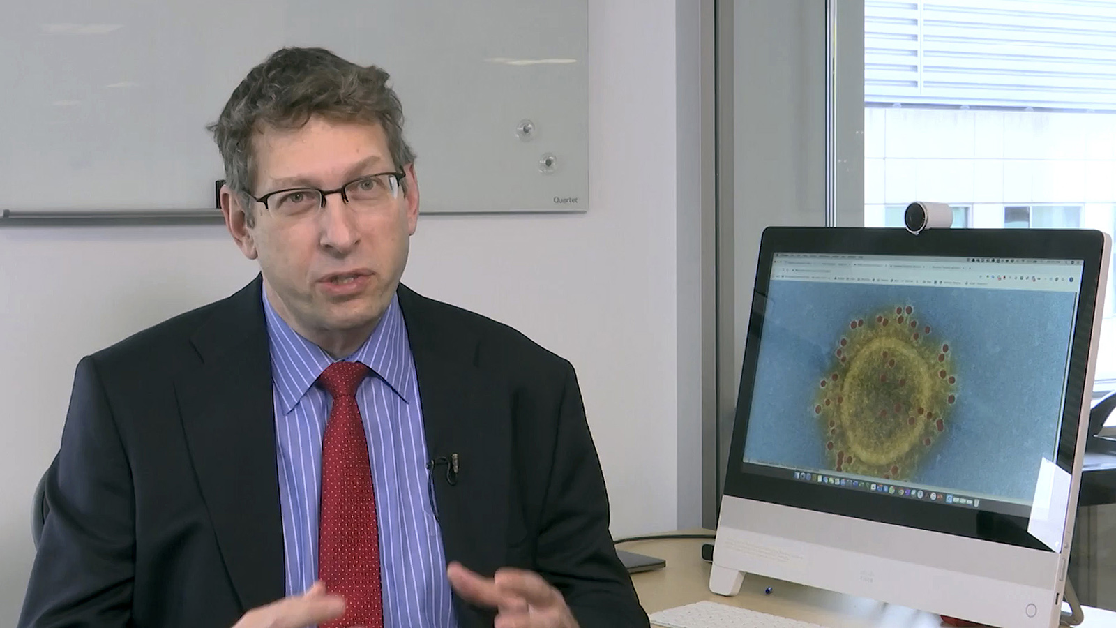In this January 27, still image from video, Moderna Chief Medical Officer Tal Zaks speaks during an interview at the company headquarters in Cambridge, Mass.