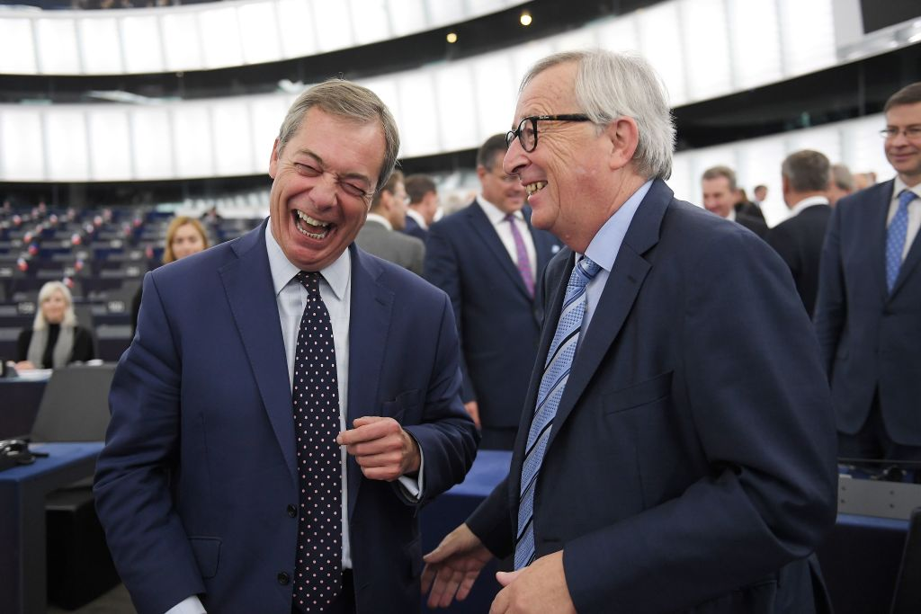 Juncker shares a laugh with Brexit foe Nigel Farage in the European Parliament on Tuesday.