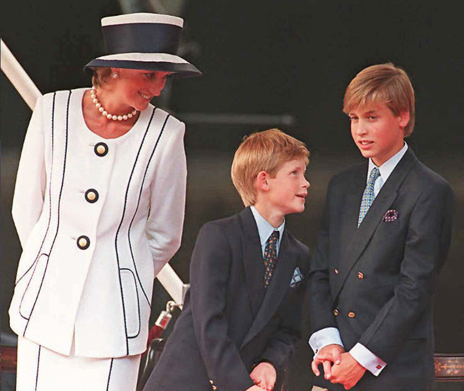 Princess Diana, Prince Harry, and Prince William gather for the commemorations of VJ Day, 19 August 1995, in London.