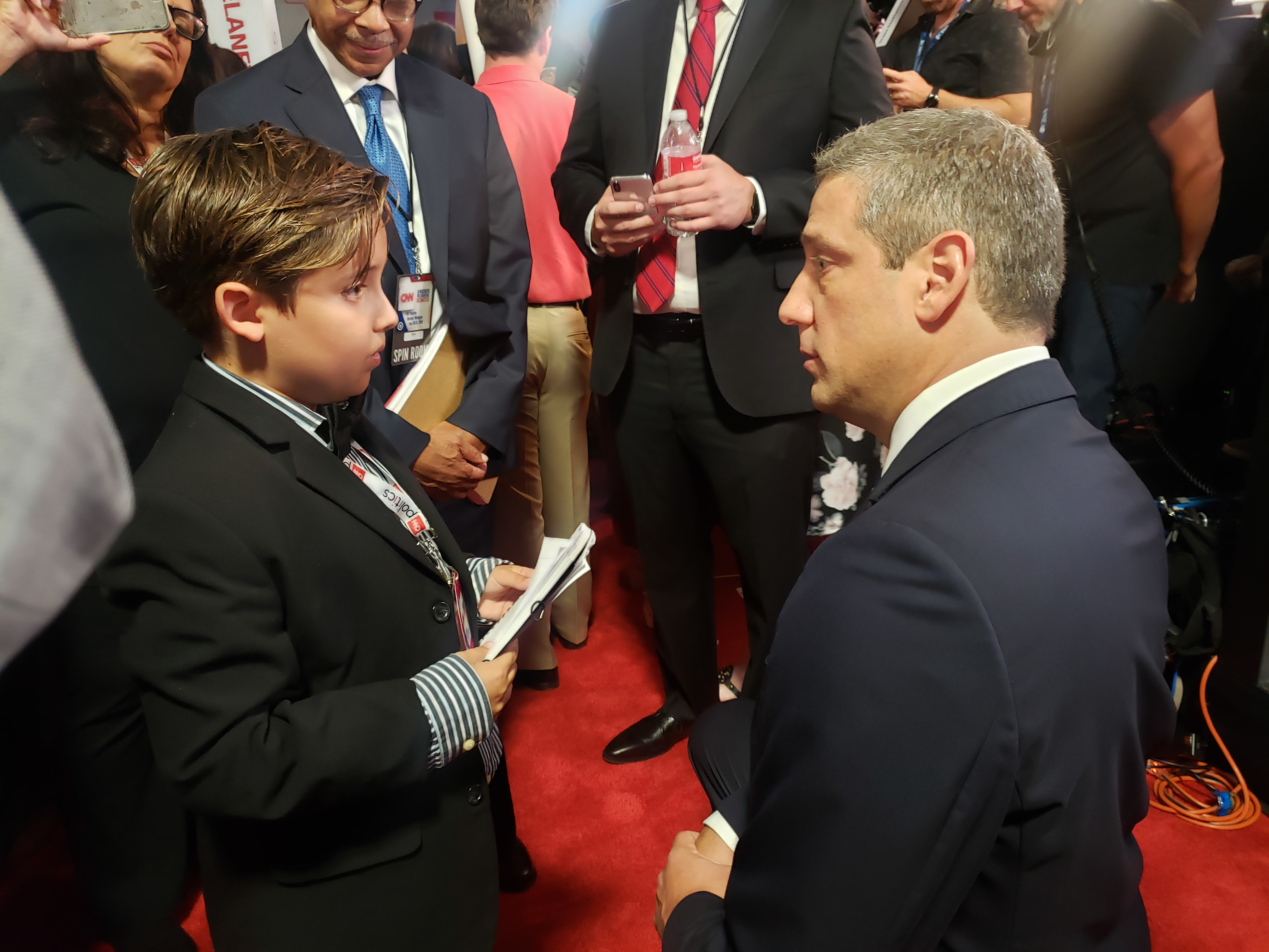 Rep. Tim Ryan talks to a young reporter in the spin room.