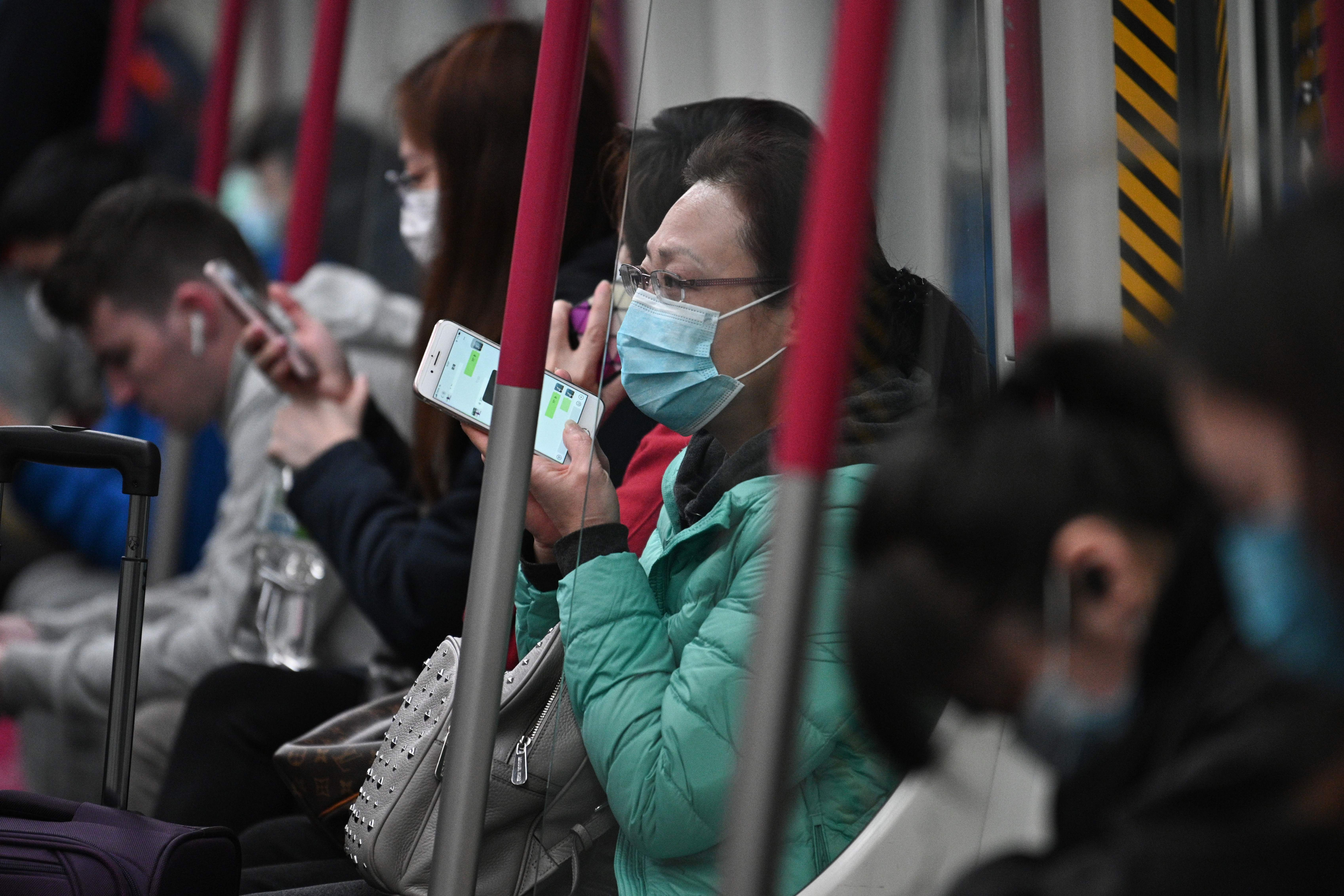 Commuters on the subway in Hong Kong on February 4, 2020.