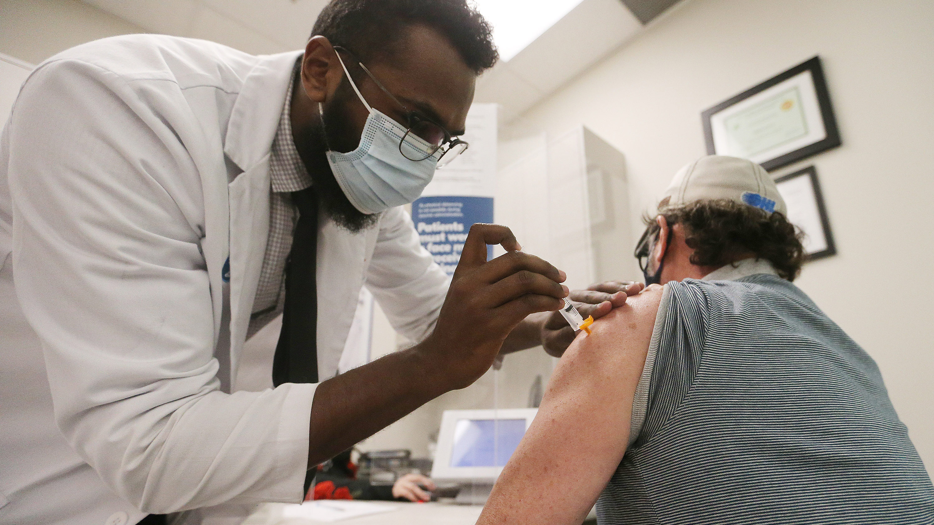 A health worker administers the AstraZeneca Covid-19 vaccine at a Shoppers Drug Mart in Toronto, on March 11.