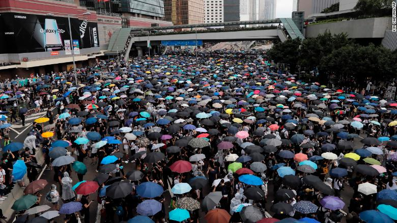 Protestors with umbrellas gather near the Legislative Council in Hong Kong.