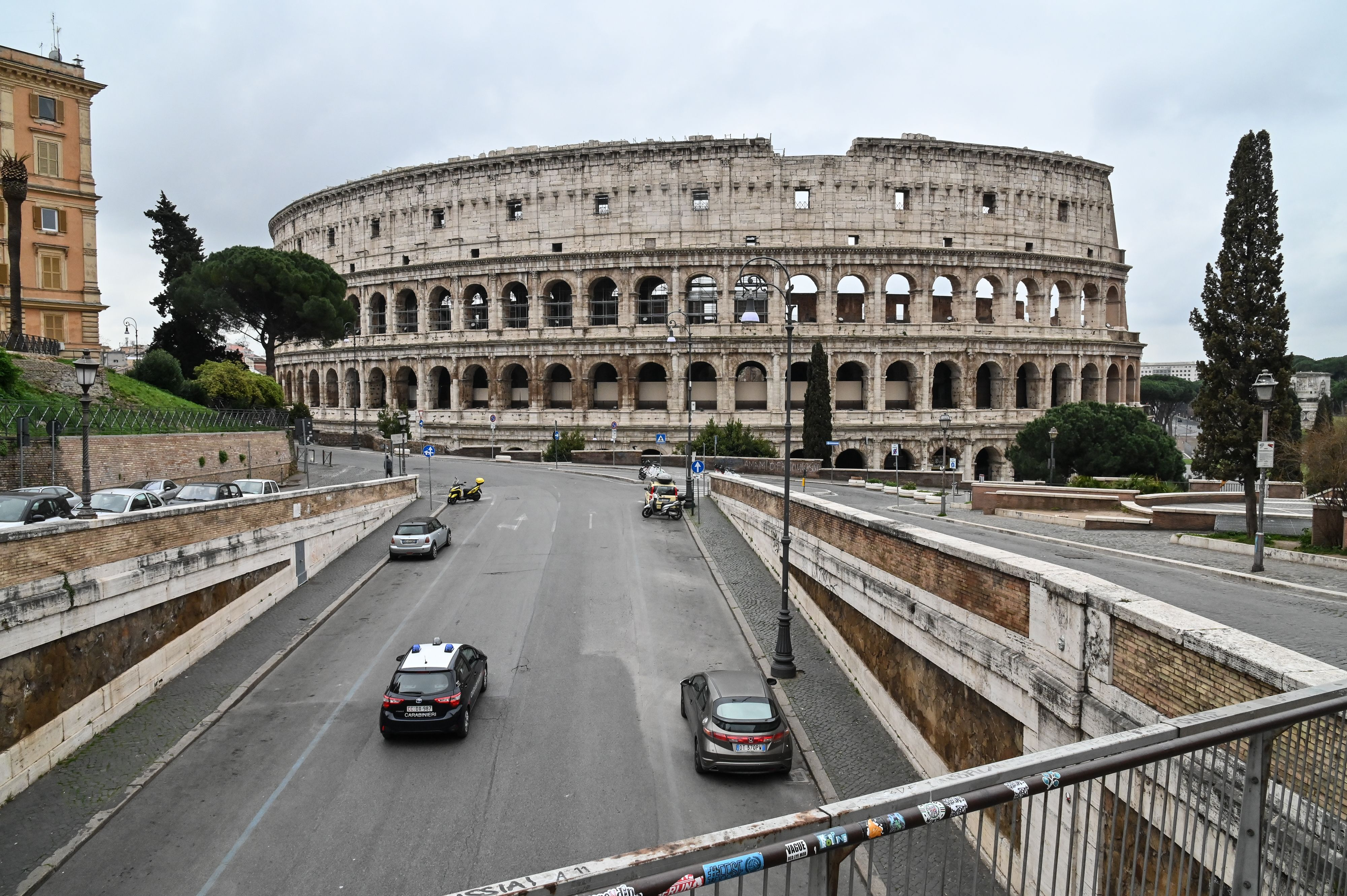 An Italian Carabinieri car checks the traffic of the street around ancient Colosseum, in central Rome on March 14, 2020.
