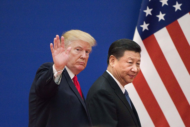 US President Donald Trump and China's President Xi Jinping leave a business leaders event at the Great Hall of the People in Beijing on November 9, 2017.