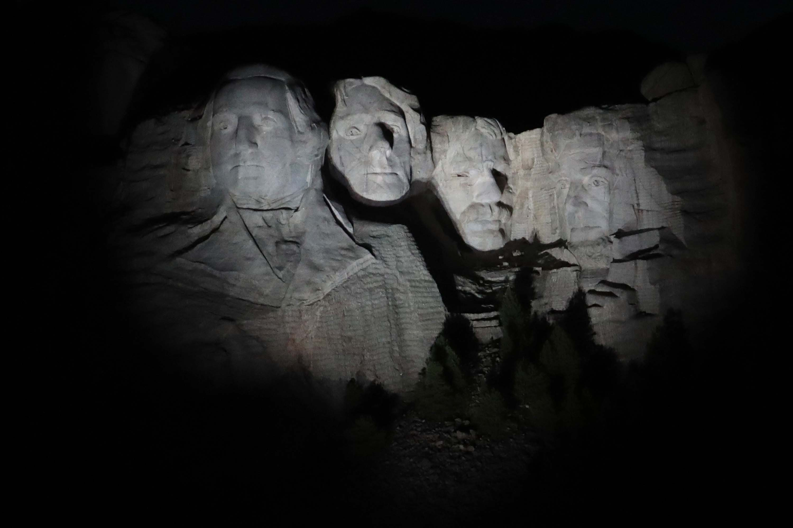 The busts of US Presidents George Washington, Thomas Jefferson, Theodore Roosevelt and Abraham Lincoln tower over the Black Hills at Mount Rushmore National Monument on July 2, near Keystone, South Dakota, ahead of President Donald Trump's visit on Friday.