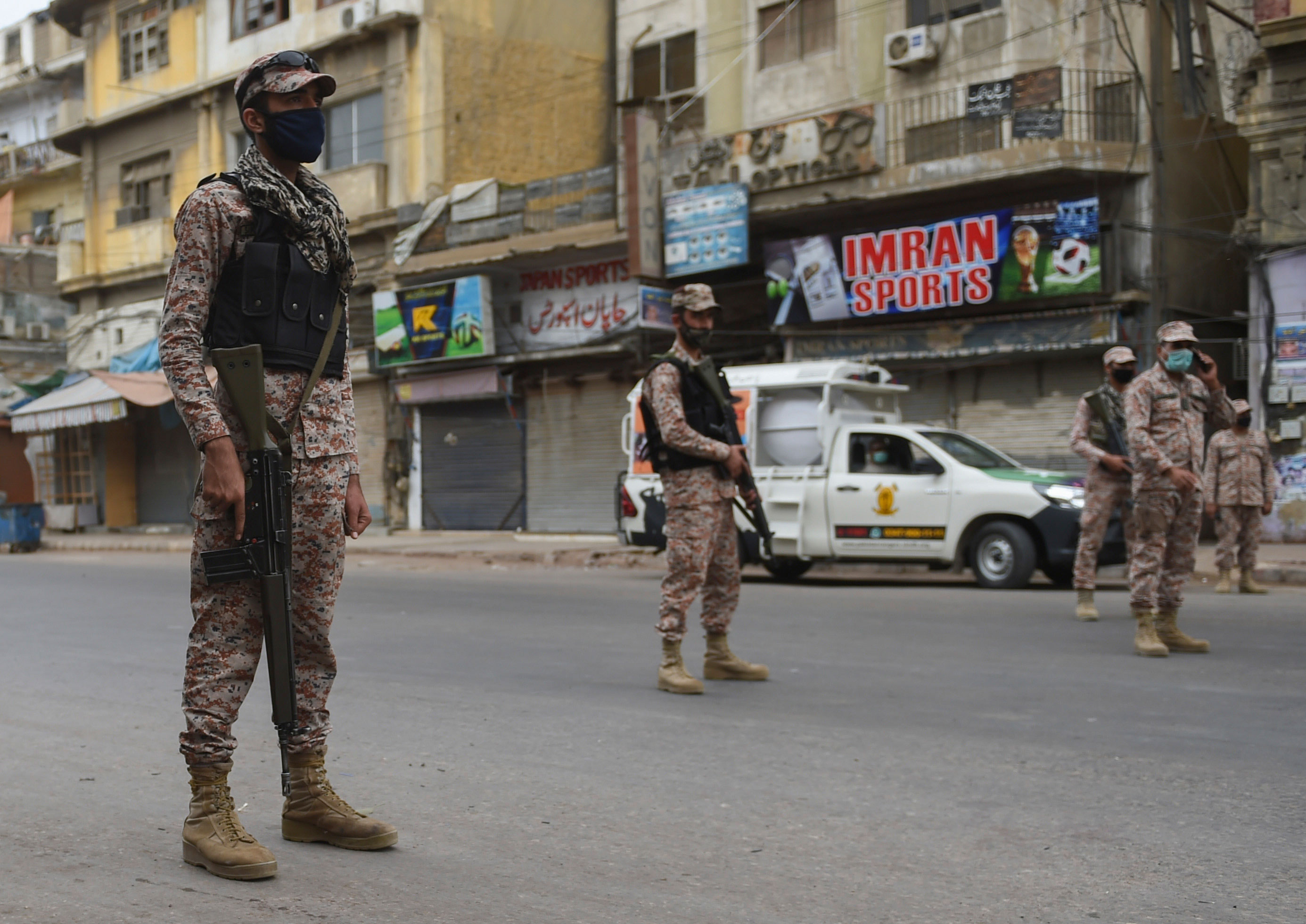 Soldiers stand guard on a deserted street during lockdown in Karachi, Pakistan on March 23.