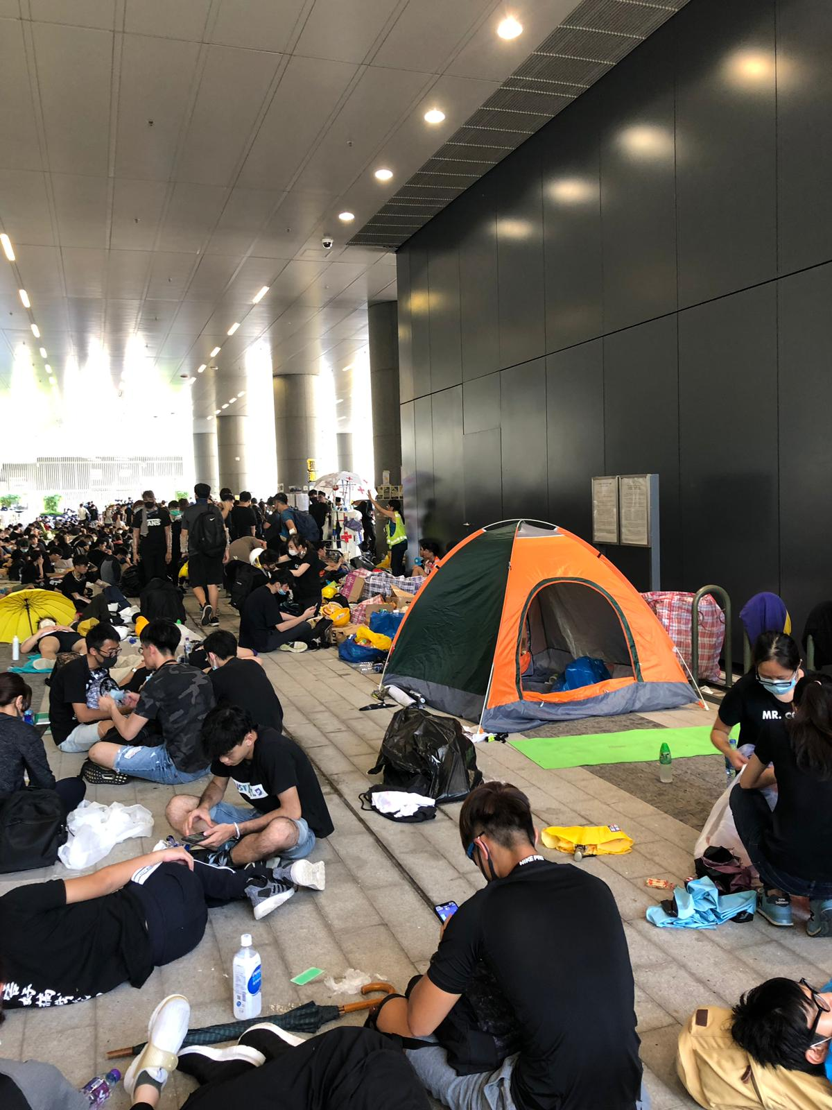 Protesters in Admiralty rest in tents and under building awnings to escape the heat.