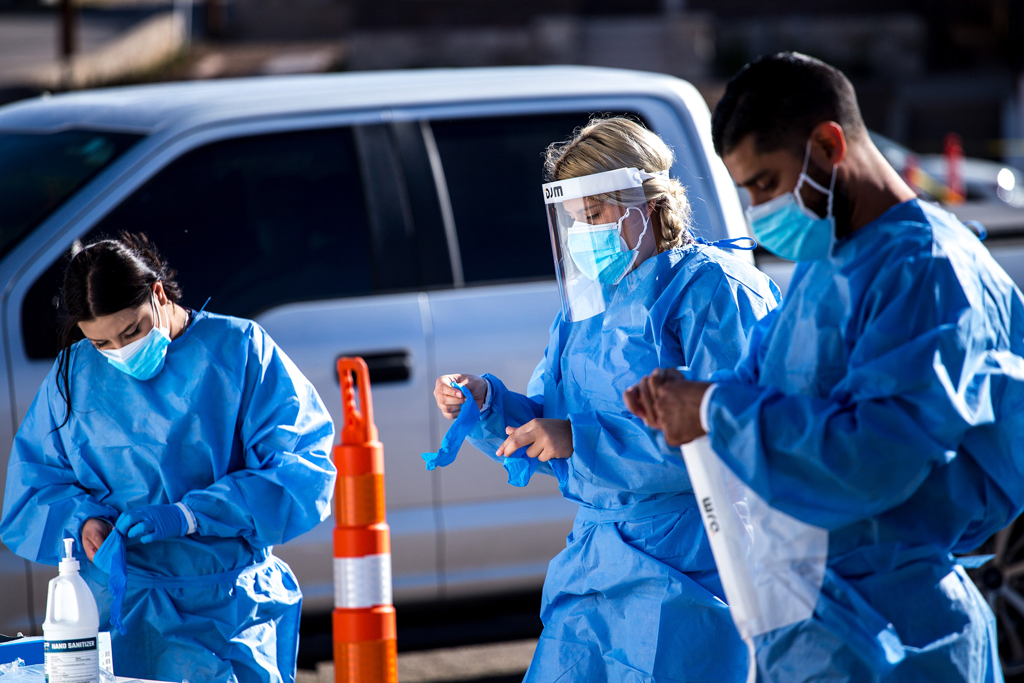 Medical workers put on personal protective equipment (PPE) before starting shifts at a Covid-19 drive-thru testing site in El Paso, Texas, on Monday, November 9.