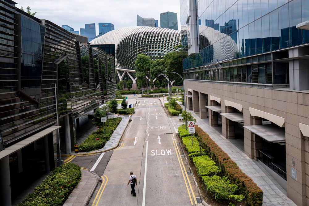 A man crosses an empty road in the Marina Bay area on April 7 in Singapore.