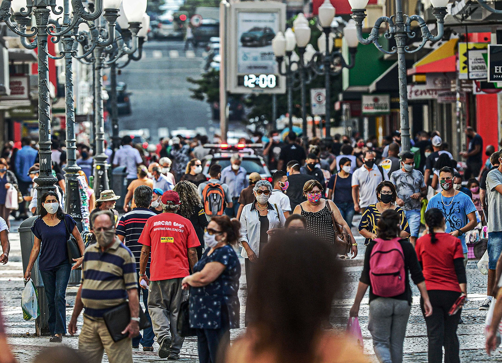 People walk through a crowded street in Florianopolis, Santa Catarina state, Brazil, on May 12.