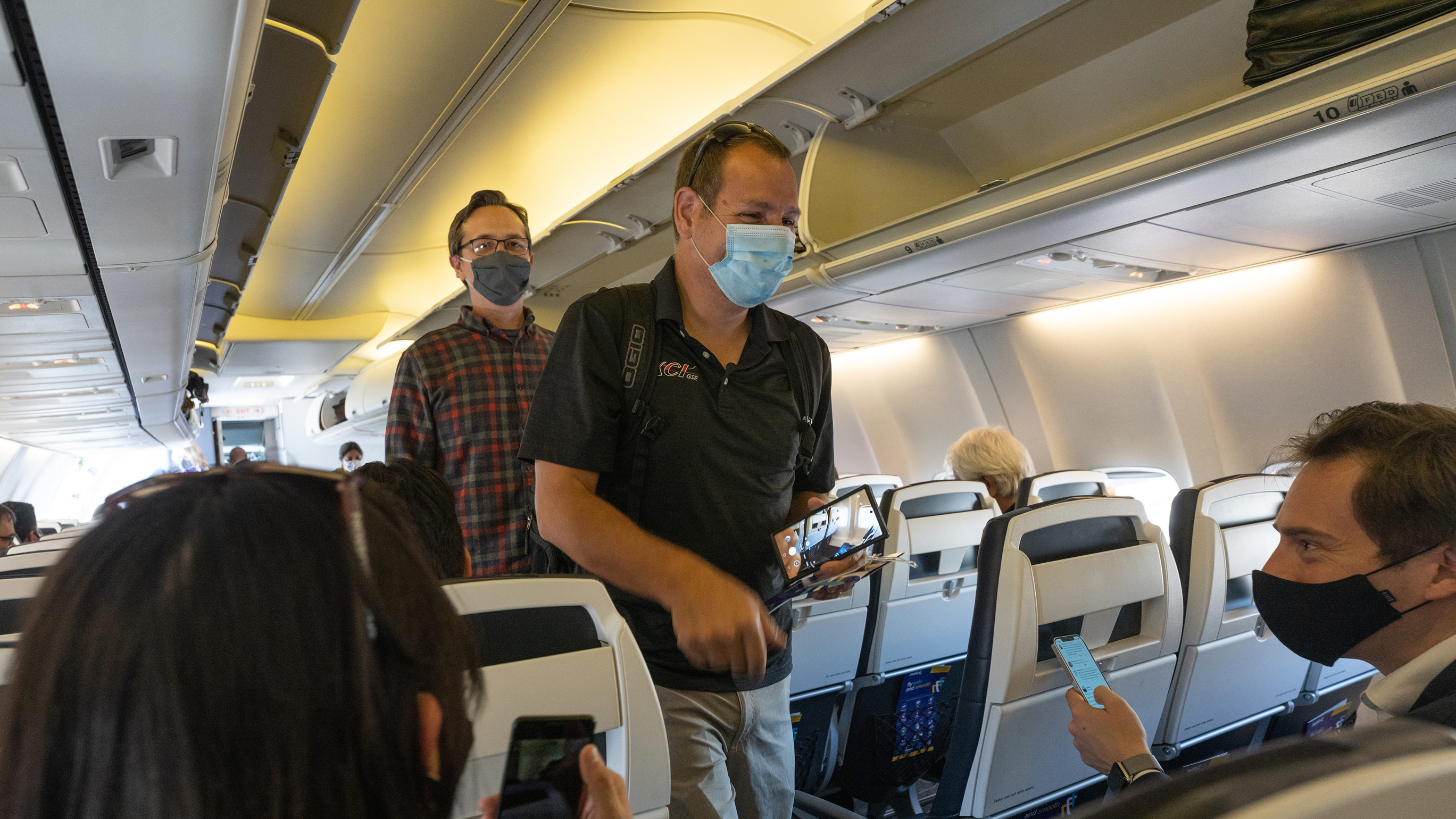 Passengers wearing protective masks masks board an Avelo Airlines flight at Hollywood Burbank Airport on Wednesday, April 28, in Burbank, California.