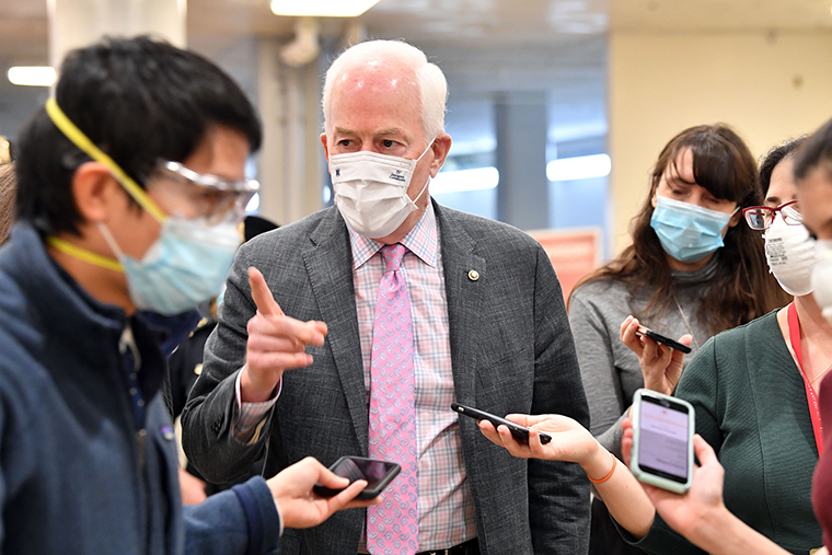 US Senator John Cornyn speaks to the press before the start of the trial of former US President Donald Trump on Tuesday, February 9.