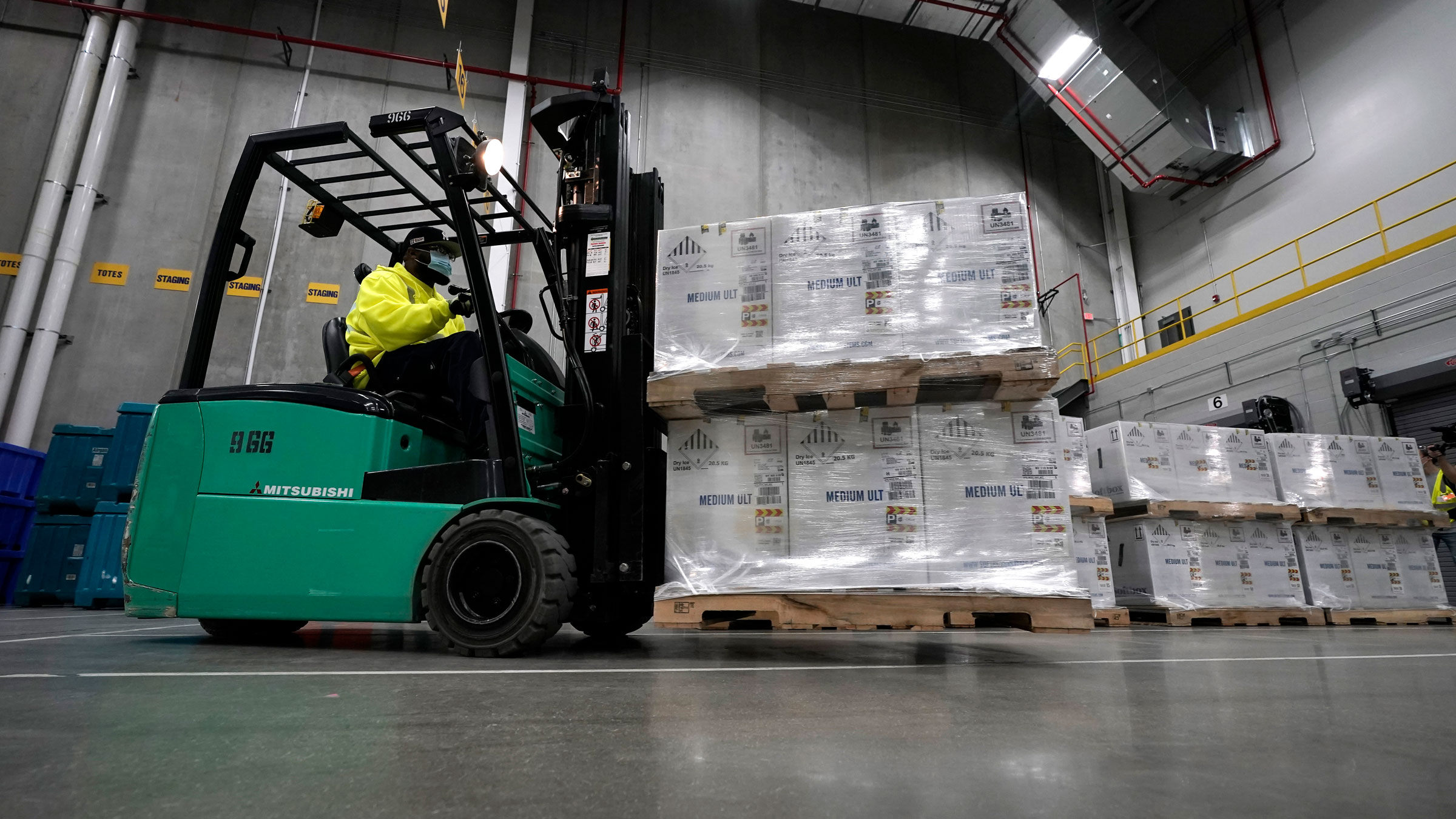 Boxes containing the Pfizer-BioNTech Covid-19 vaccine are prepared to be shipped from a manufacturing plant in Portage, Michigan, in December.