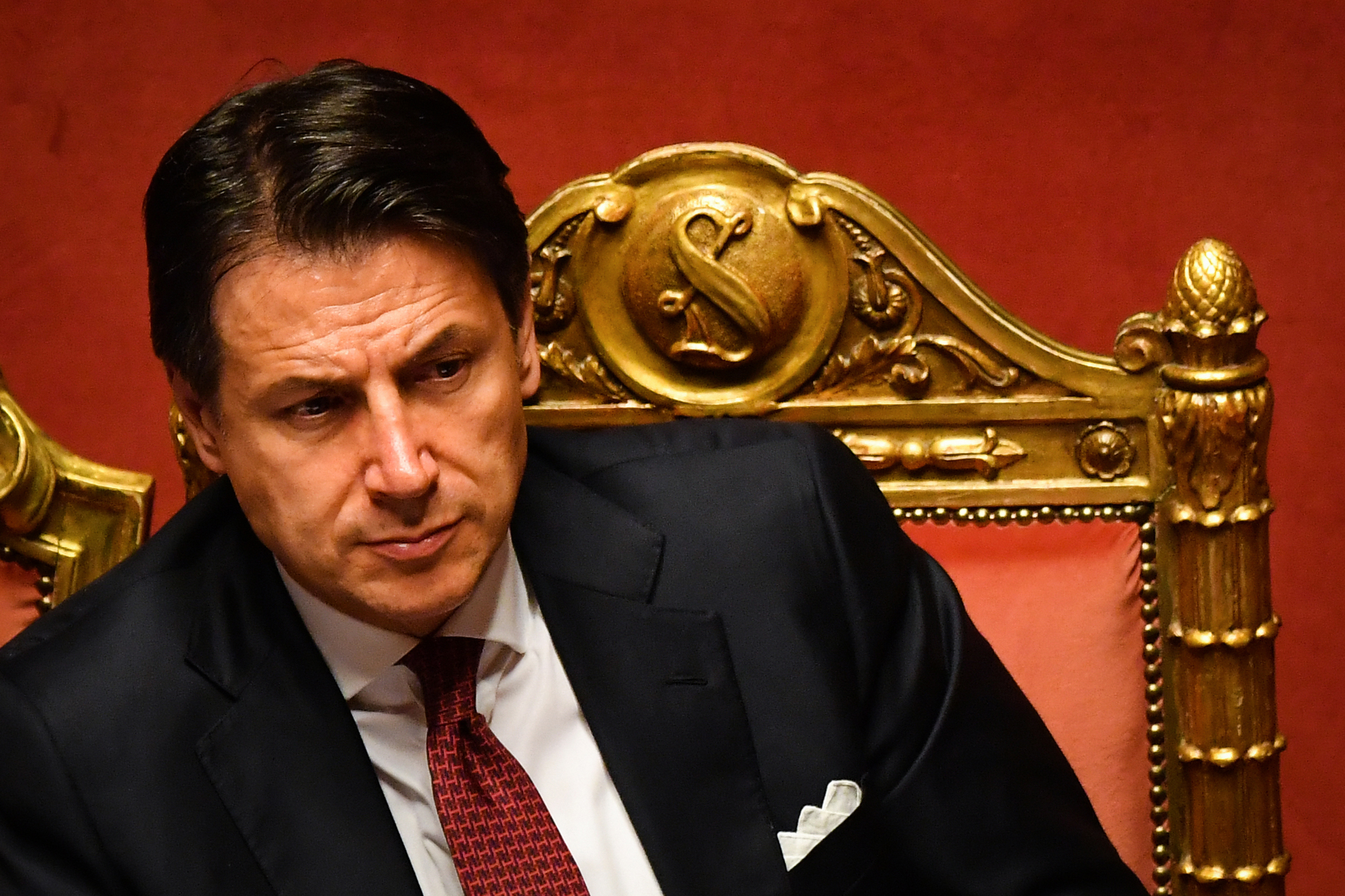 Italian Prime Minister Giuseppe Conte reacts after delivering a speech at the Italian Senate in Rome on Aug. 20, 2019.