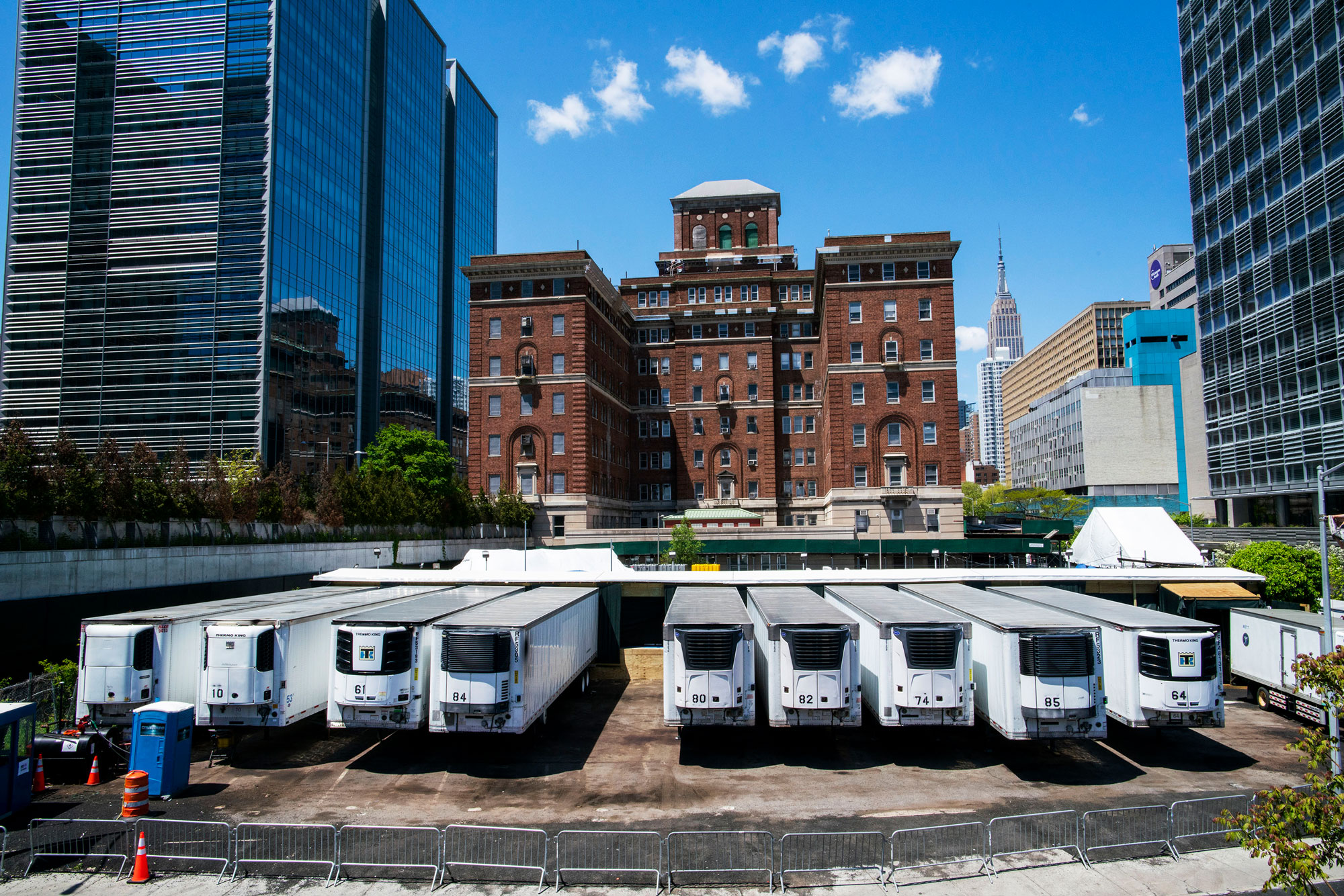 Trucks used as temporary morgues are seen outside the New York City Chief Medical Examiner's office on May 12 in New York.