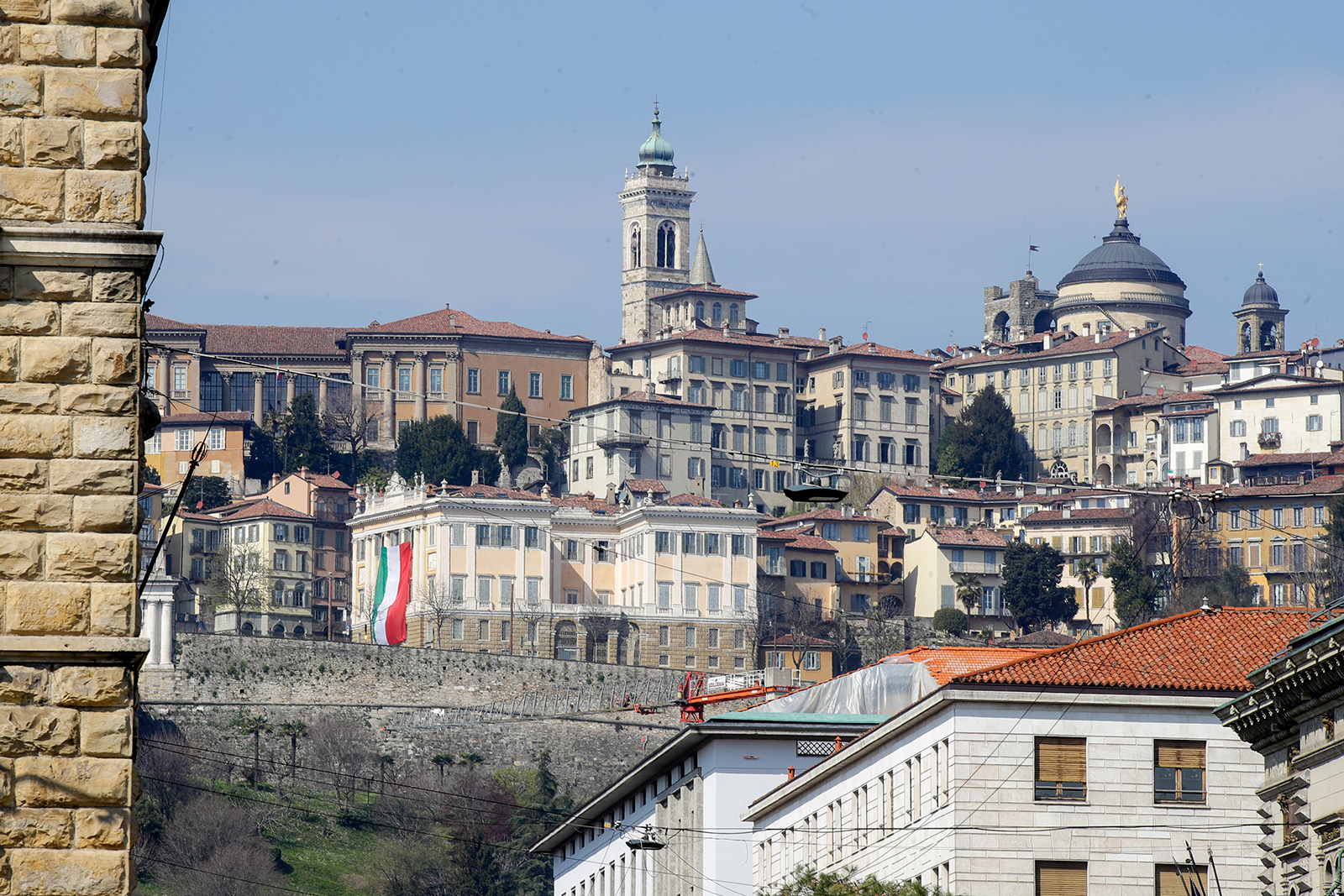A large flag of Italy hangs from the facade of Palazzo Medolago Albani in Bergamo Alta, the heart of the hardest-hit province in Italy, in the Lombardy region, on March 17.