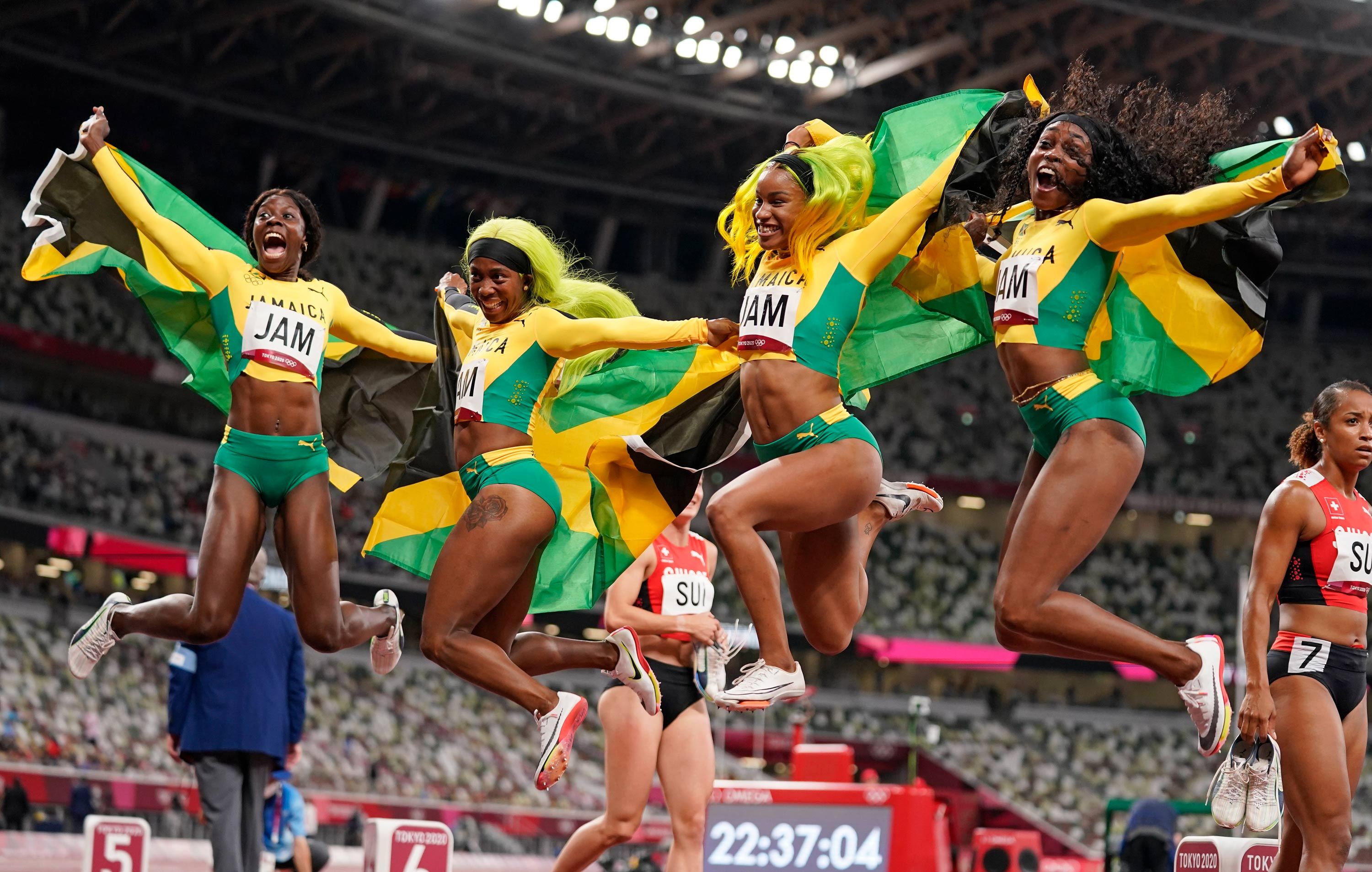 From left, Jamaica's Shericka Jackson, Shelly-Ann Fraser-Pryce, Briana Williams and Elaine Thompson-Herah celebrate after winning the gold medal in the 4 x 100-meter relay on August 6.