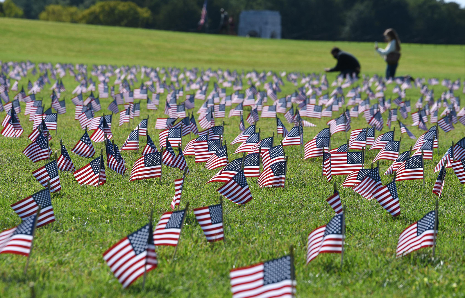 Volunteers place American flags on the Washington National Mall in memory of over 200,000 Americans who have lost their lives to Covid-19 in Washington, DC, on September 22.
