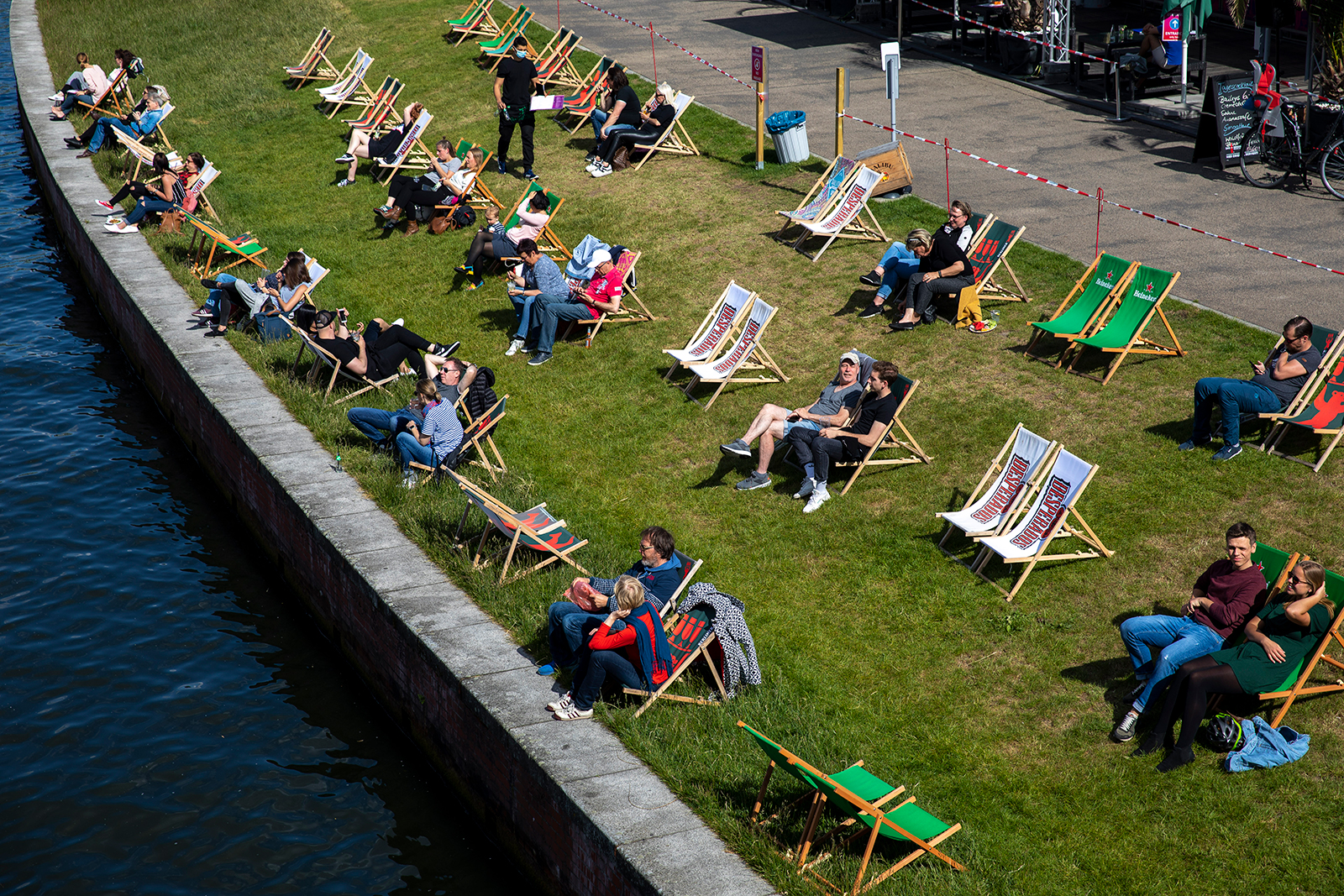 Visitors sit in a bar on chairs that are set apart to provide social distance during the coronavirus crisis on May 26, in Berlin.
