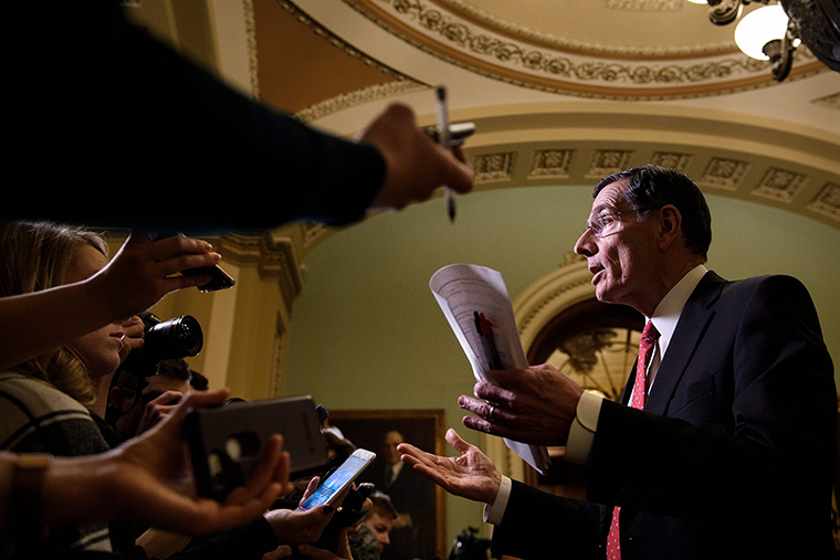 Senator John Barrasso speaks to reporters.