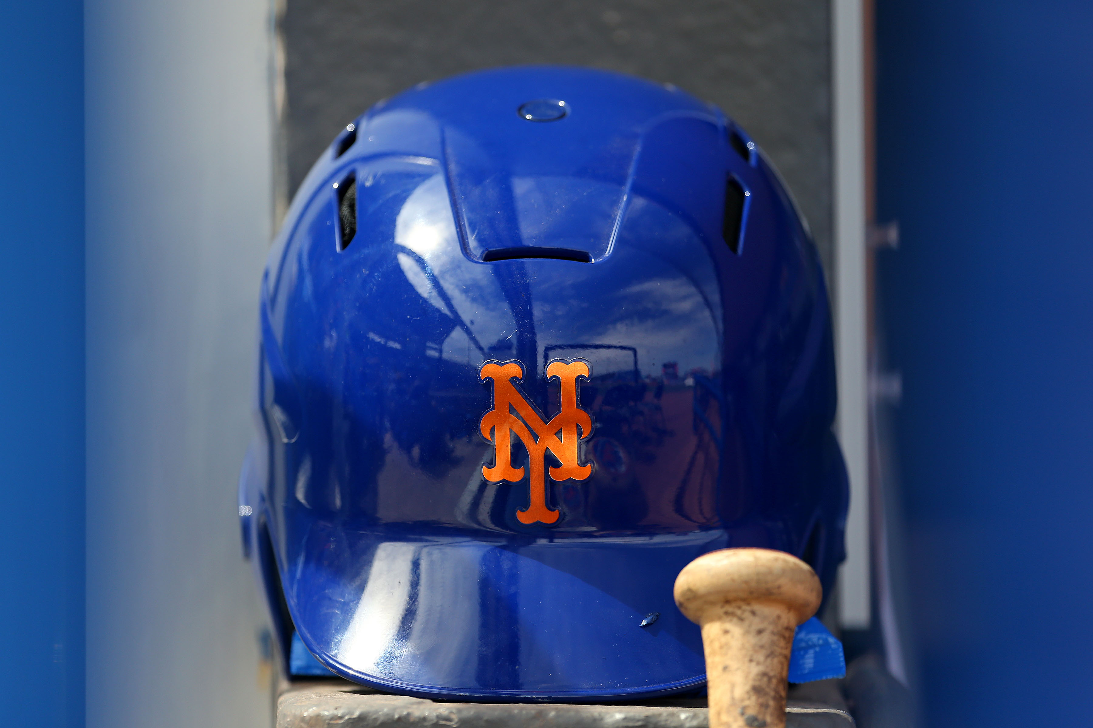 A New York Mets batting helmet is seen in the dugout on March 8 before a spring training game in Port St. Lucie, Florida.