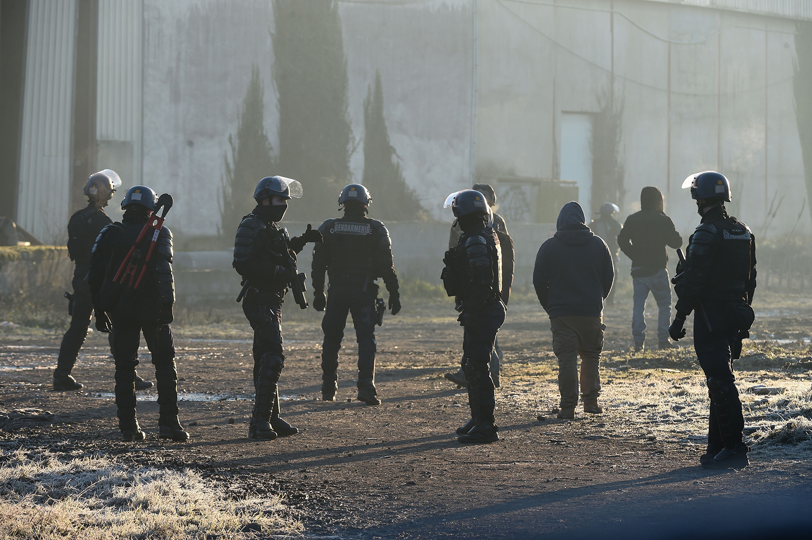 French Gendarmes break up a rave in Lieuron, France, on January 2.
