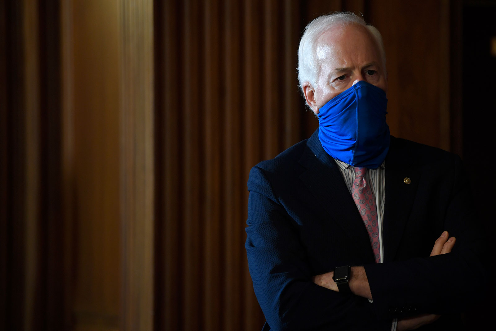 Sen. John Cornyn listens during a news conference in Washington, DC, on Monday, July 27.