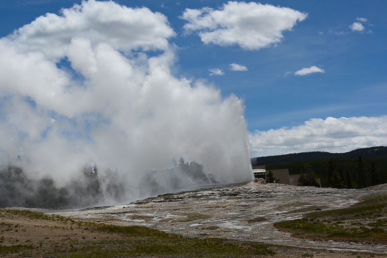 Old Faithful geyser erupts in Yellowstone National Park in Wyoming on June 11, 2019