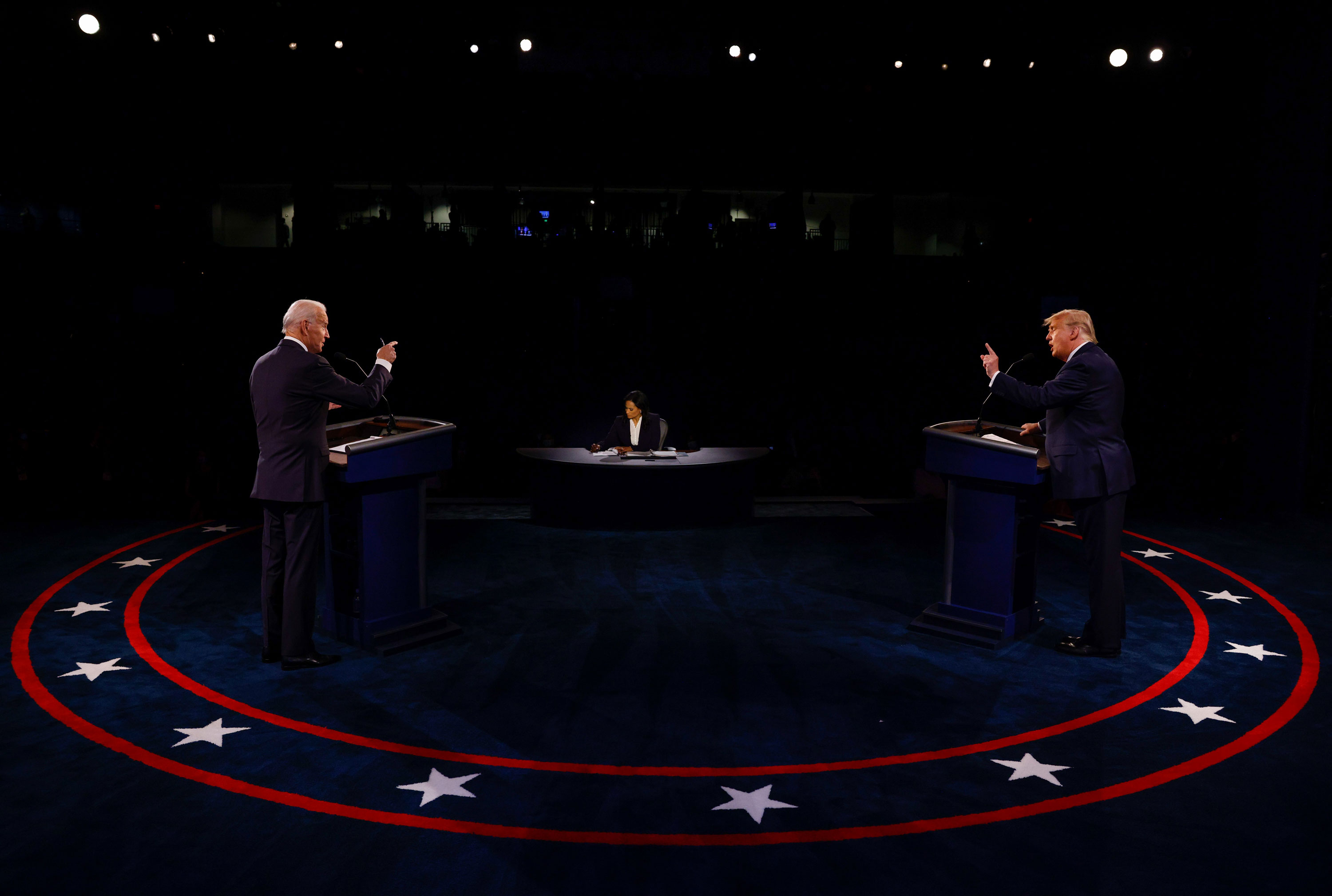 President Donald Trump, right, and Democratic candidate Joe Biden debate each other in Nashville, Tennessee, on October 22. At center is moderator Kristen Welker.