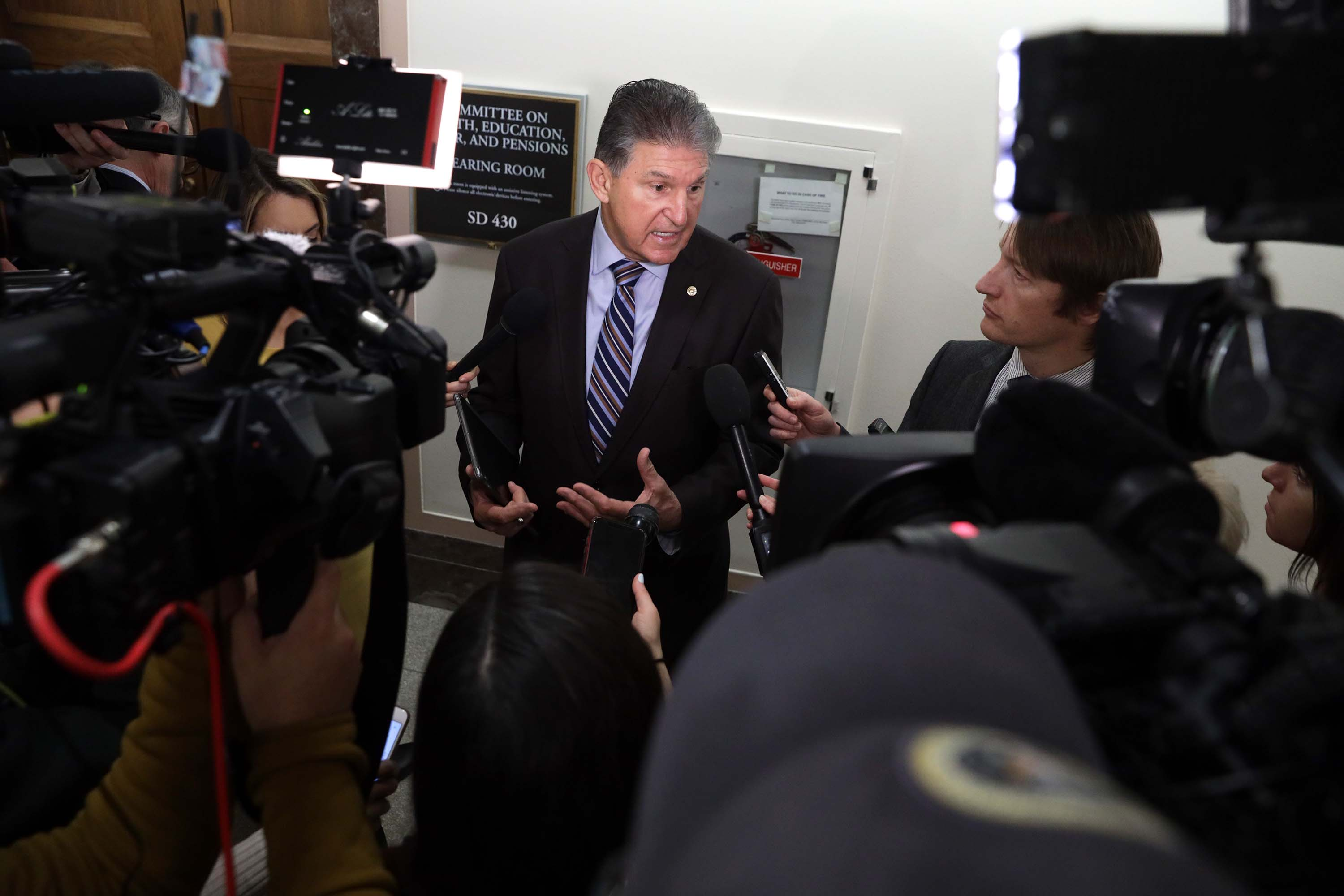 Sen. Joe Manchin speaks to the media after a briefing on the coronavirus outbreak on Capitol Hill in Washington, D.C., on March 12.