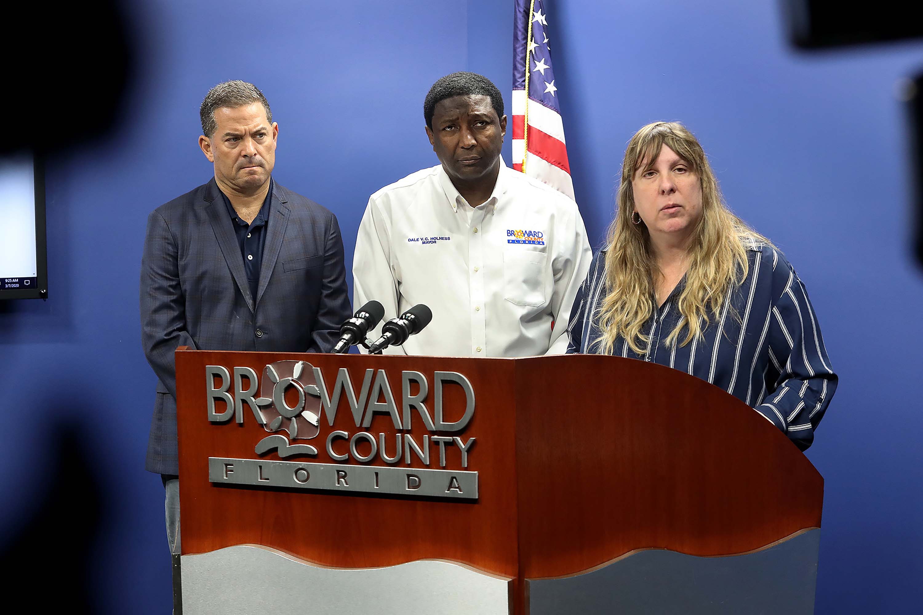 Broward County commissioner Michael Udine, Mayor Dale V.C. Holness, and Dr. Paula Thaqi, Director of the Florida Department of Health in Broward County take questions from the media about coronavirus cases in Plantation, Florida, on March 7.