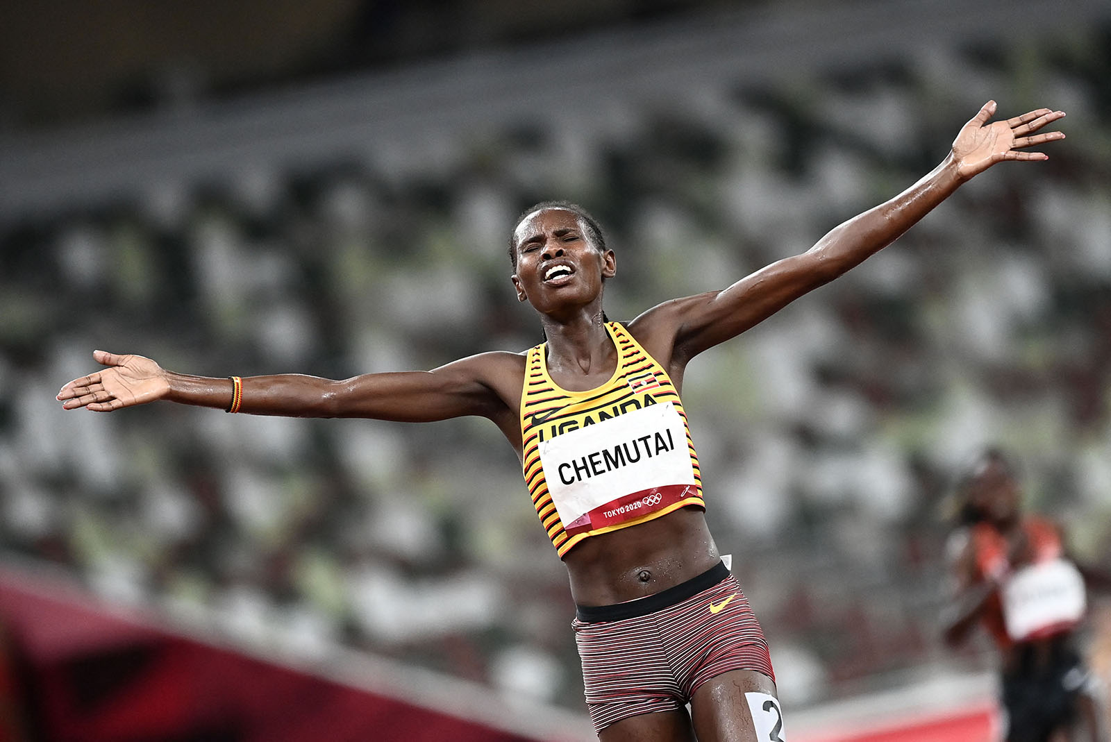 Uganda's Peruth Chemutai reacts after winning the women's 3000m steeplechase final on August 4.