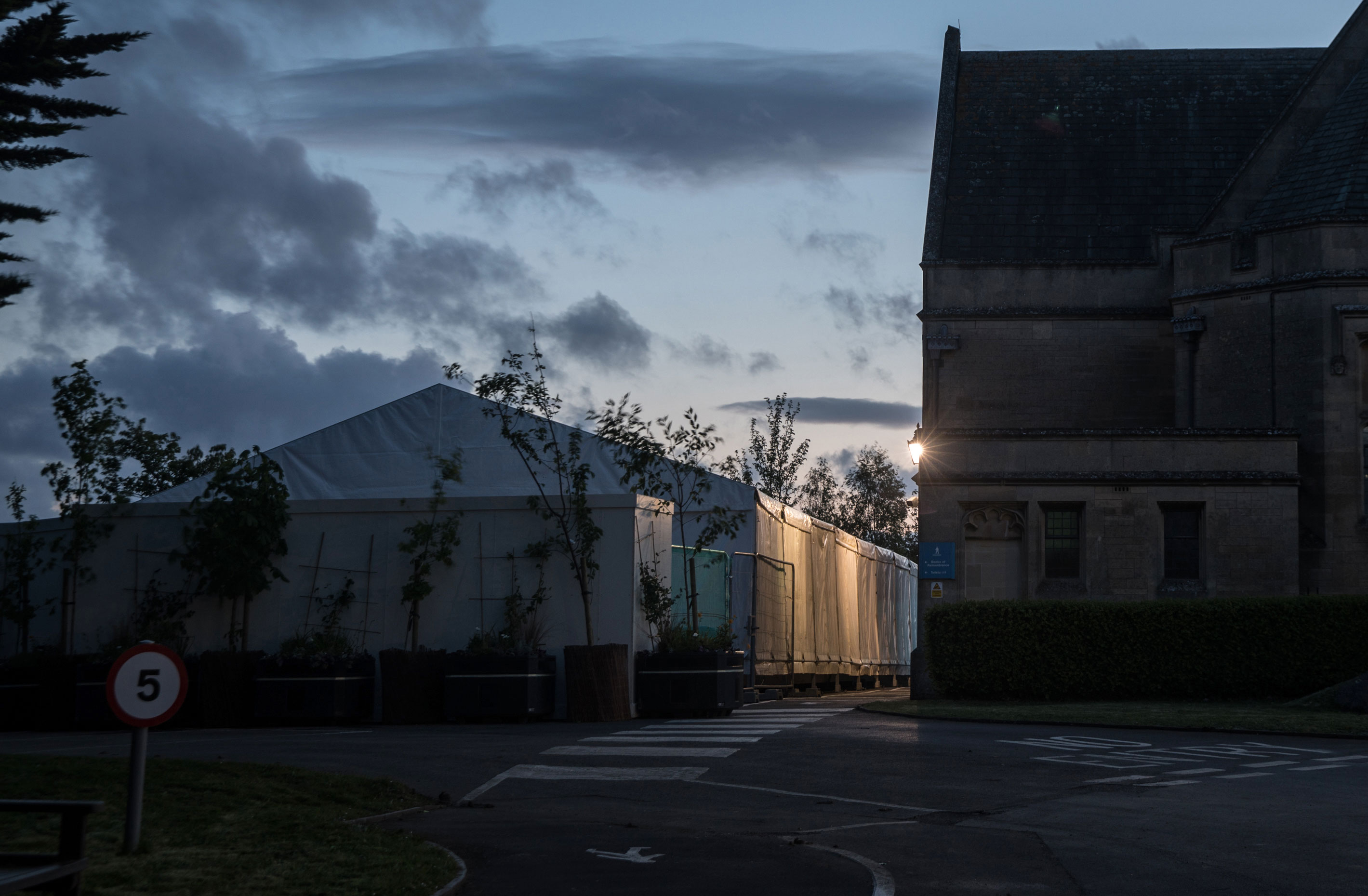 Night falls on a temporary morgue that has been constructed on the grounds of Haycombe Cemetery to accommodate victims of COVID-19 on May 1 in Bath, United Kingdom.