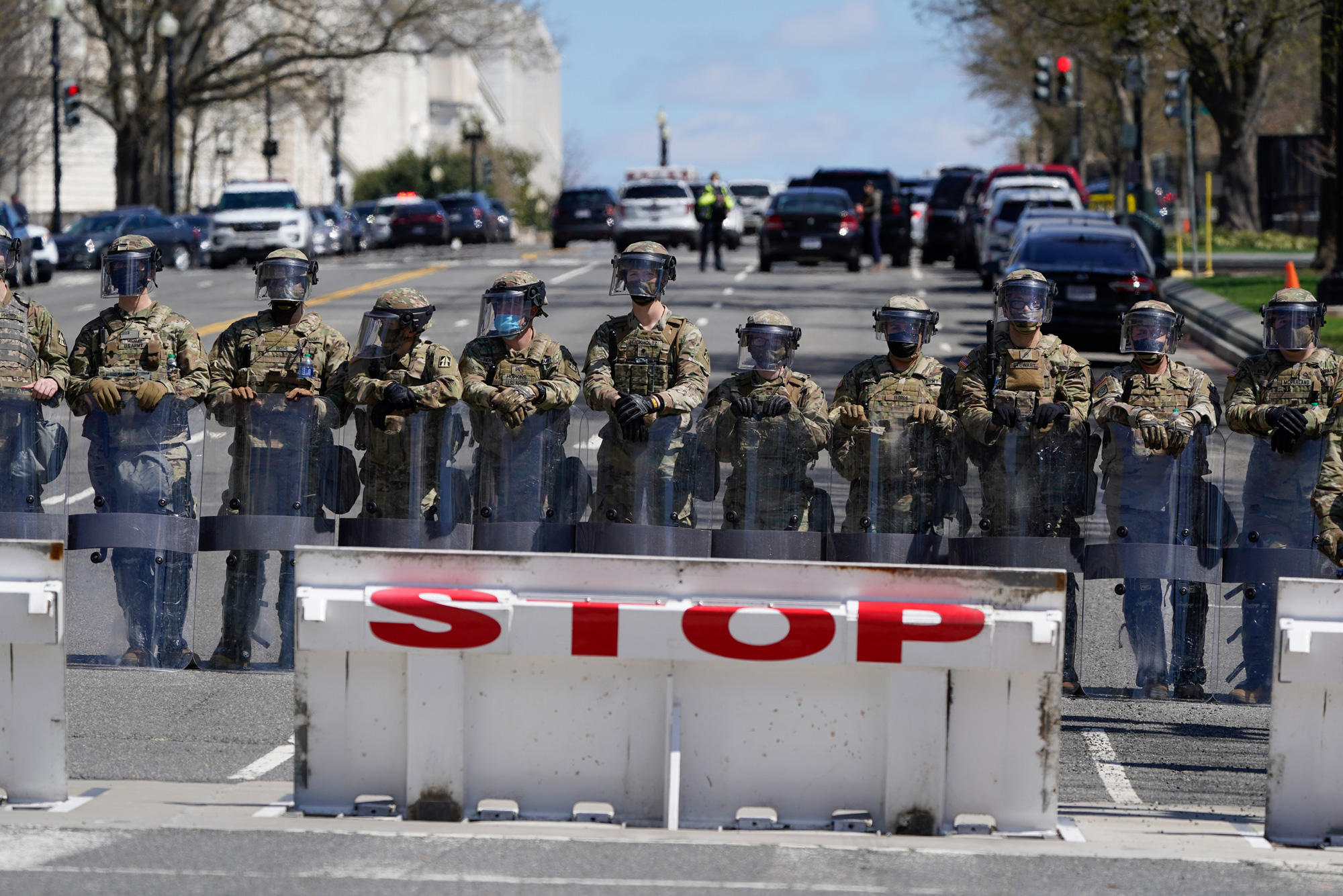 Troops stand guard near the scene of a car that crashed into a barrier on Capitol Hill in Washington, DC, on April 2.