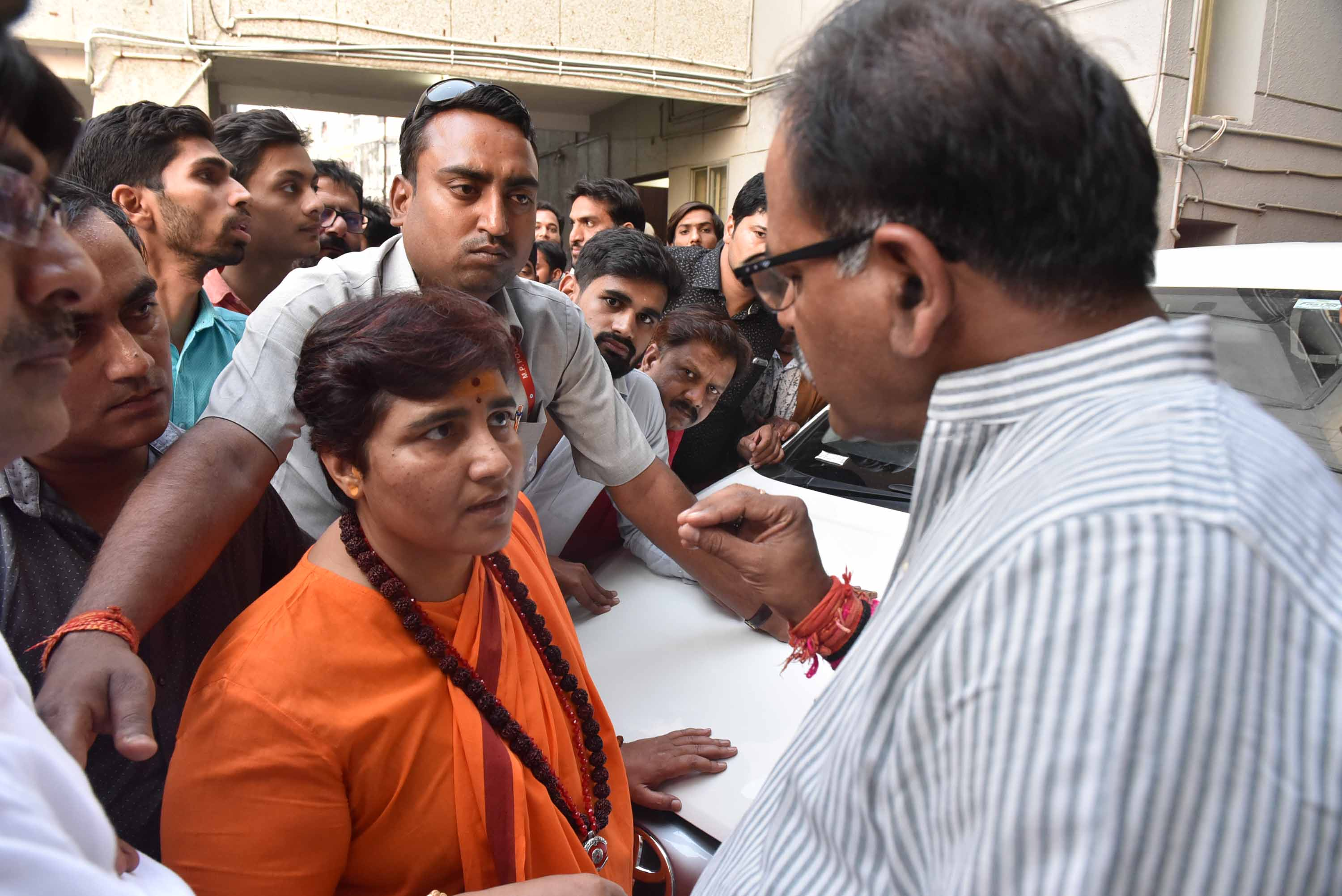 Pragya Thakur (in orange) is seen after a meeting at a state BJP office on April 17 in Bhopal, India.