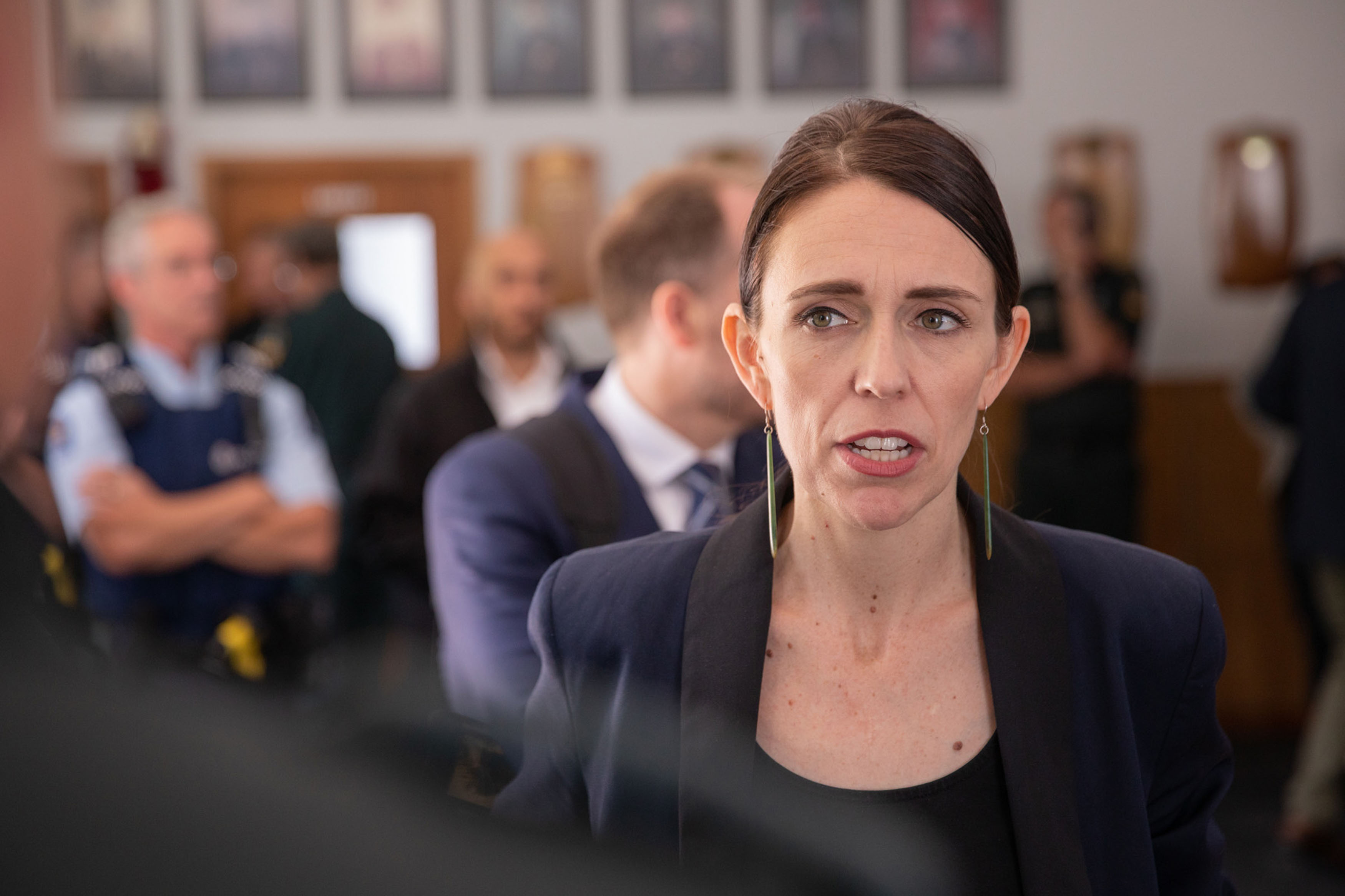 New Zealand Prime Minister Jacinda Ardern meets with first responders at the Whakatane Fire Station on December 10.