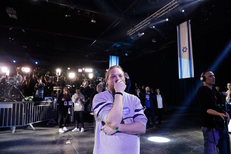 Blue and White party supporter reacts at first exit polls for the Israeli elections at party's headquarters in Tel Aviv, Israel, Monday, March 2.