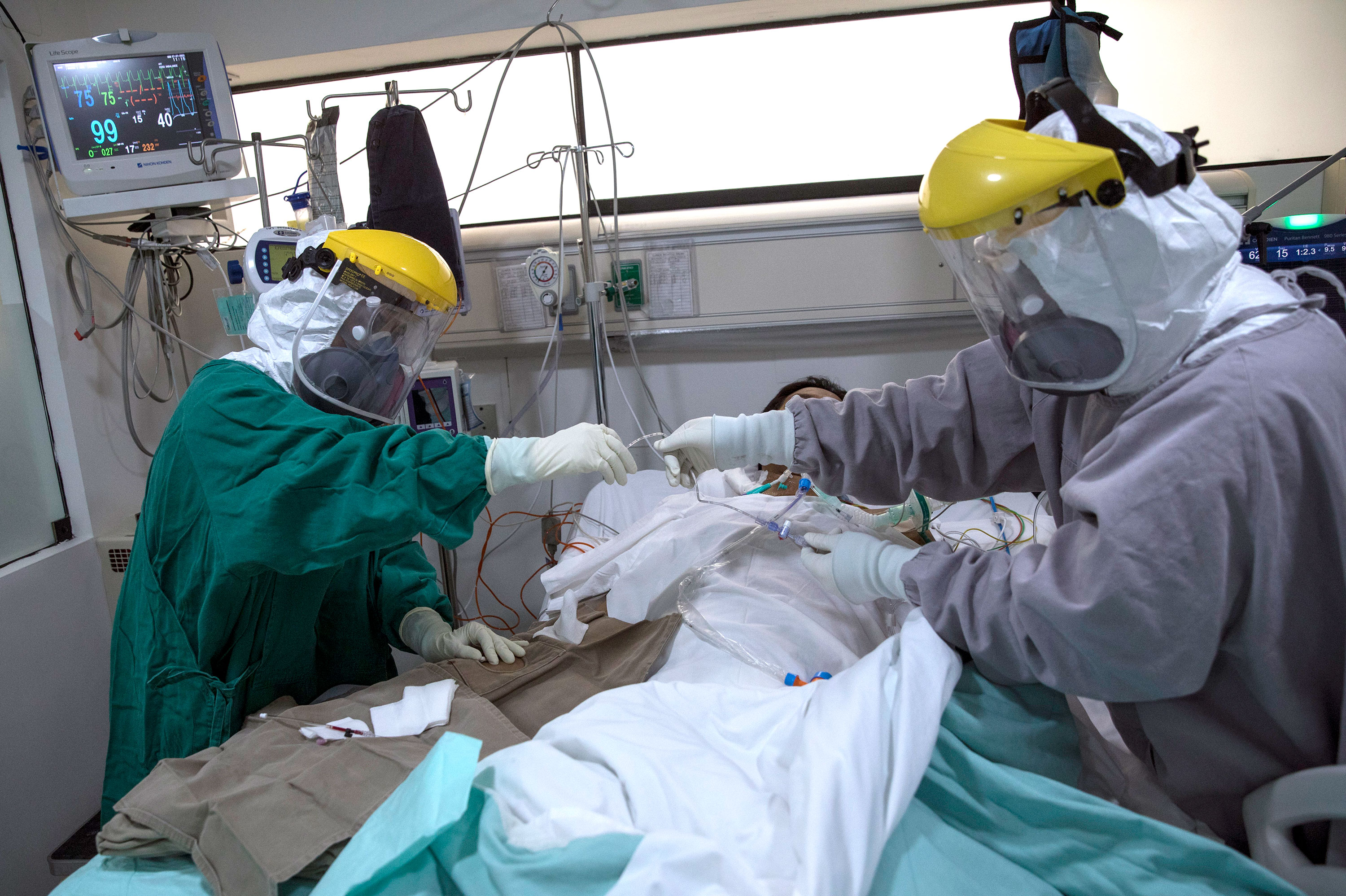 Doctors attend to a coronavirus patient in the intensive care unit at Ricardo Palma Hospital on July 7 in Lima, Peru.