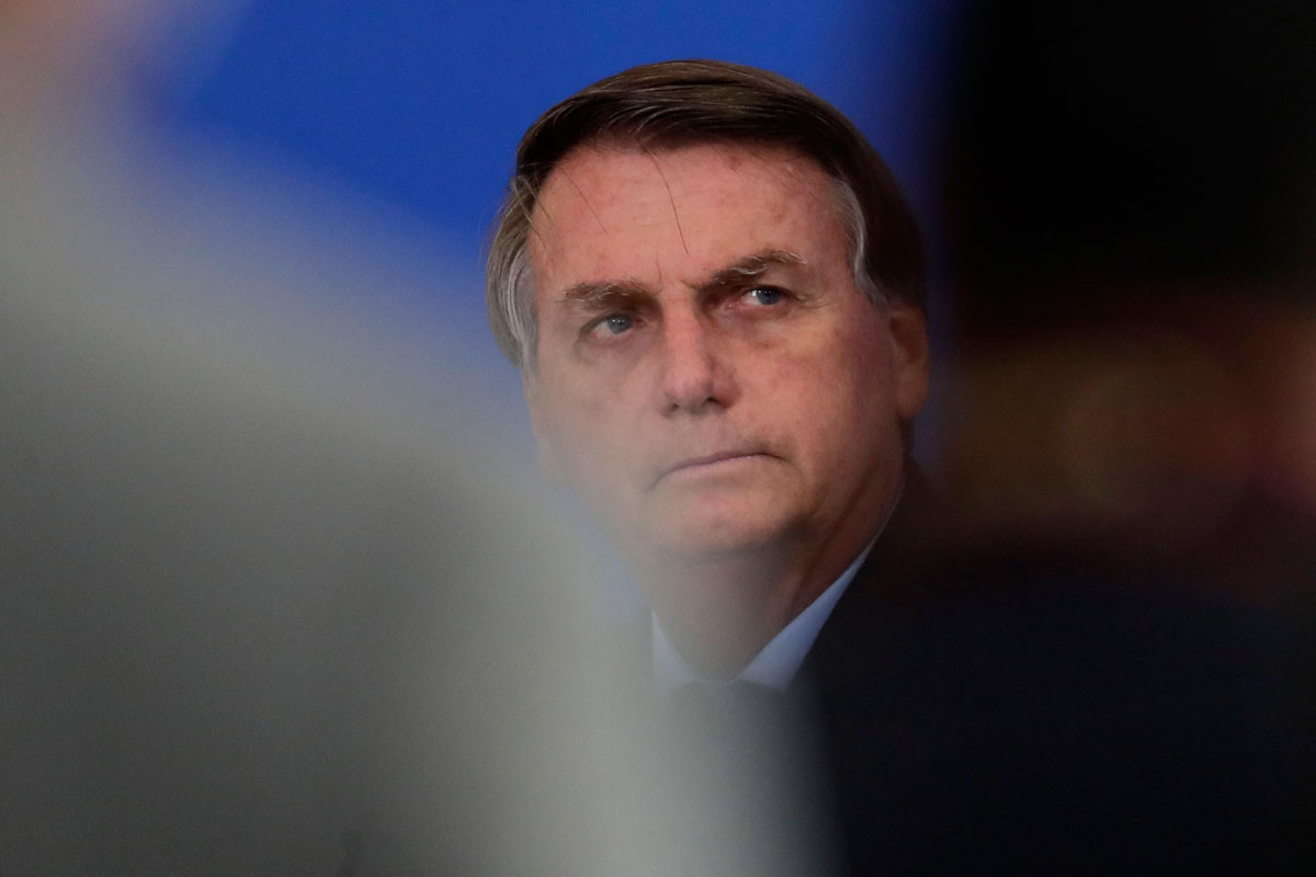 President Jair Bolsonaro looks on during a ceremony at the Planalto presidential palace, in Brasilia, Brazil on November 26.
