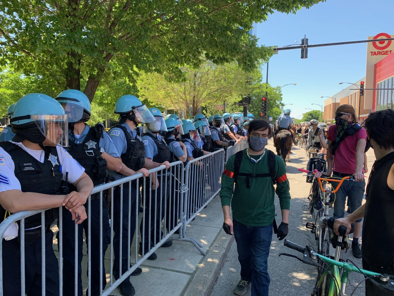 Protesters march past Chicago police on June 6, 2020.